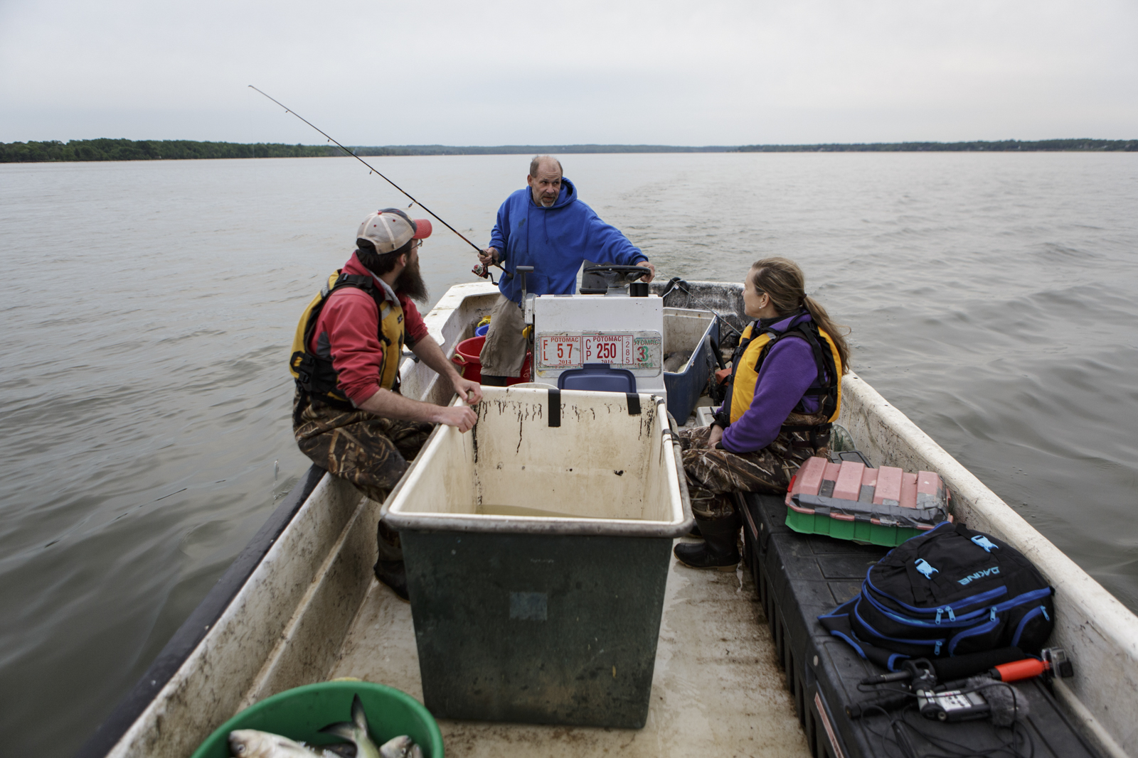 Brad Harley (center) is the son of the waterman, Mike Harley, who originally helped mount the stocking program to restore American shad in the 1990s, after his father's death, he now helps the biologists catch the fish they need for the program.