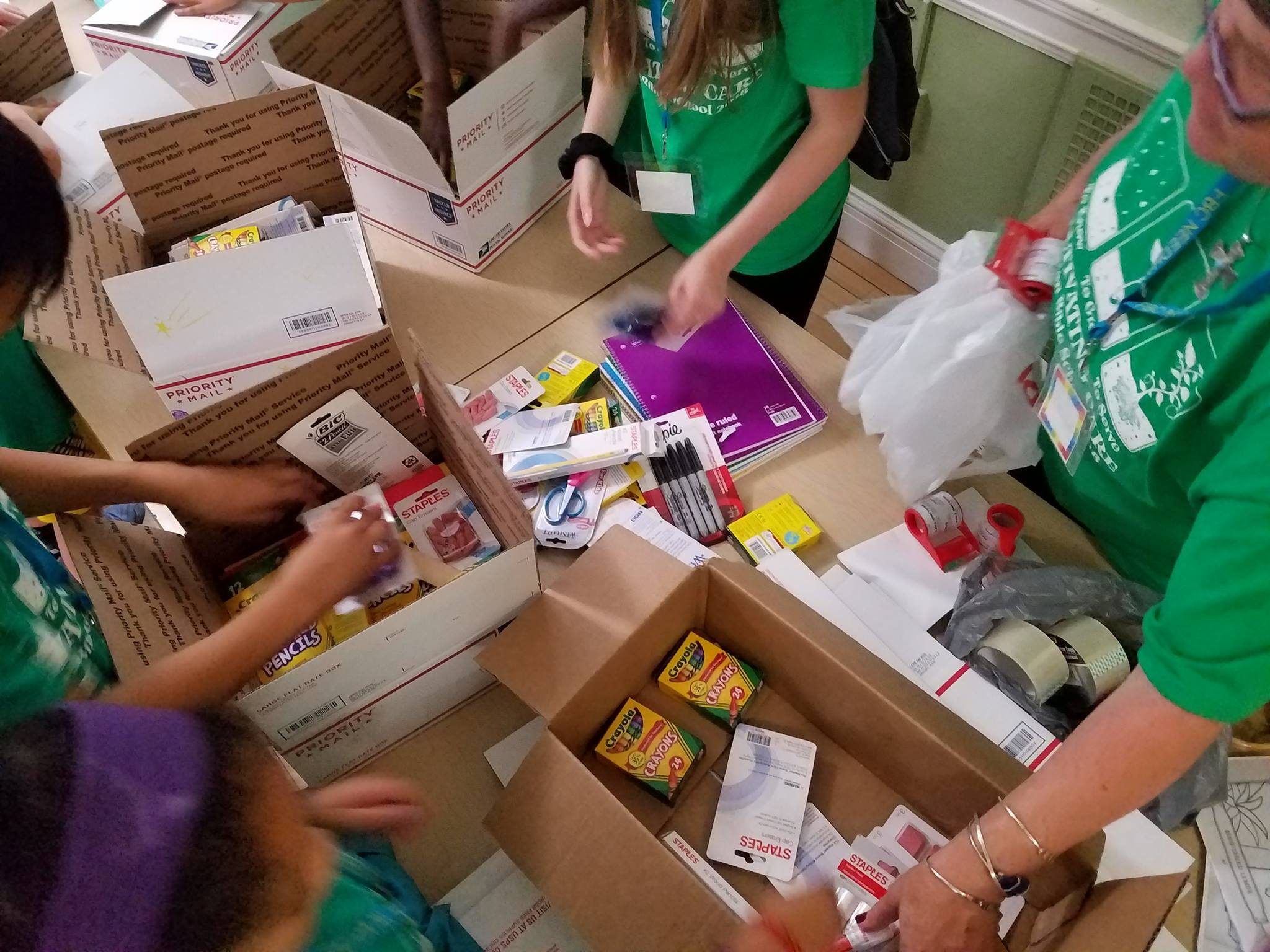 Packing boxes of school supplies for our neighbors in Puerto Rico.