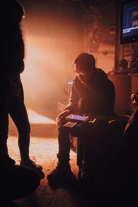 "On the set of ""ZOMBIE"", drenched in post-apocalyptic light."