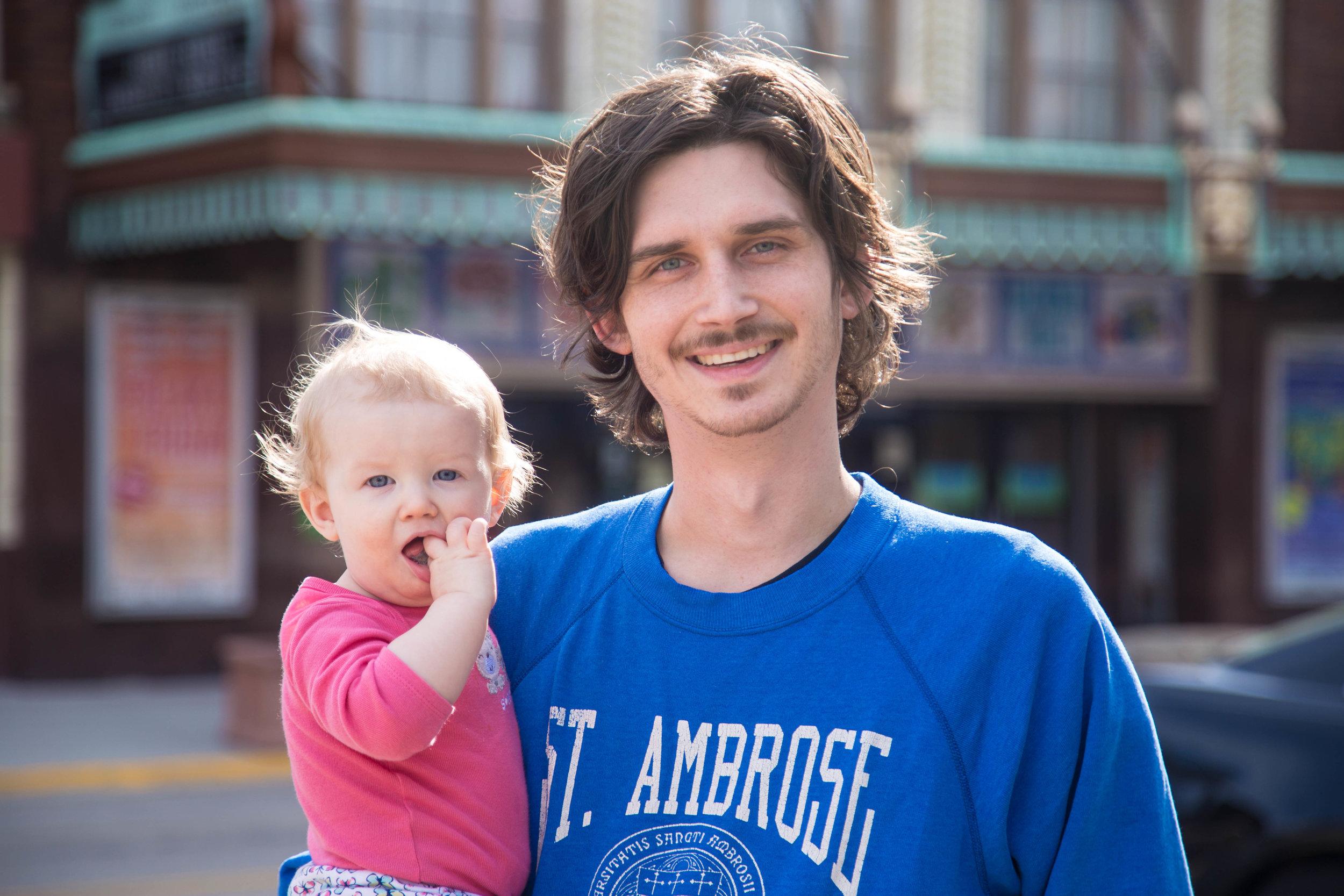Rock Island Alderman Dylan Parker holds his daughter Antigone in their home 5th Ward. (One Illinois/Zach Sigelko)