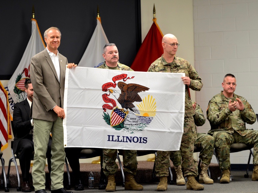Gov. Bruce Rauner sends off National Guard troops to Afghanistan with an Illinois flag in 2016. (Illinois National Guard Public Affairs Office)