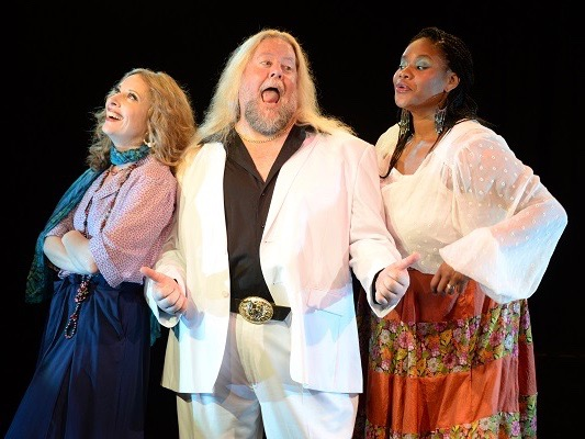 "Quetta Carpenter, Steven Young, and Dee Dee Batteast star in ""The Merry Wives of Windsor,"" reconsidered as ""The Housewives of Normal, Ill."" (Illinois Shakespeare Festival/Steven Smedley)"