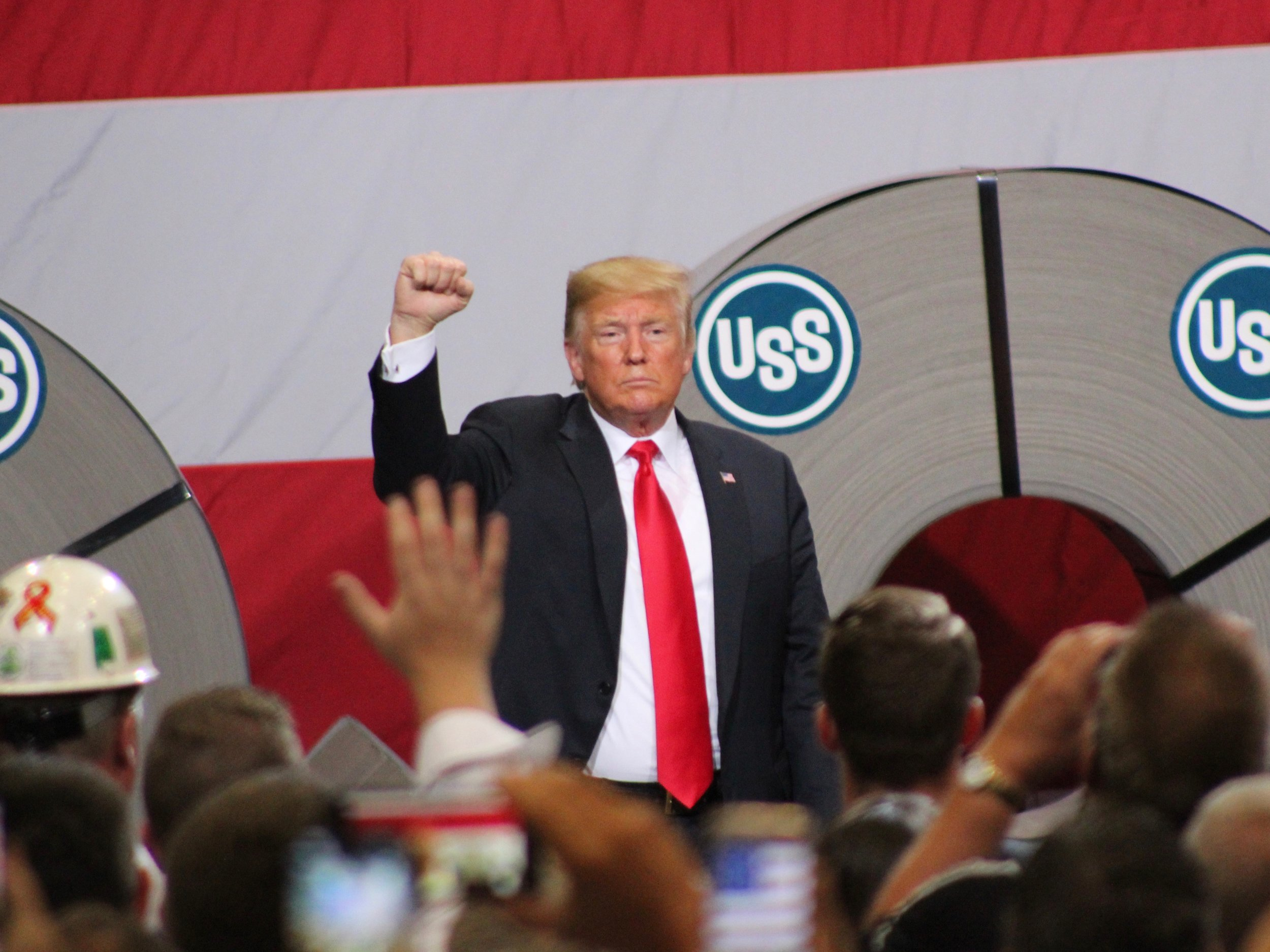 President Trump proclaims solidarity with steelworkers at the end of his speech at U.S. Steel's Granite City Works. (One Illinois/Ted Cox)