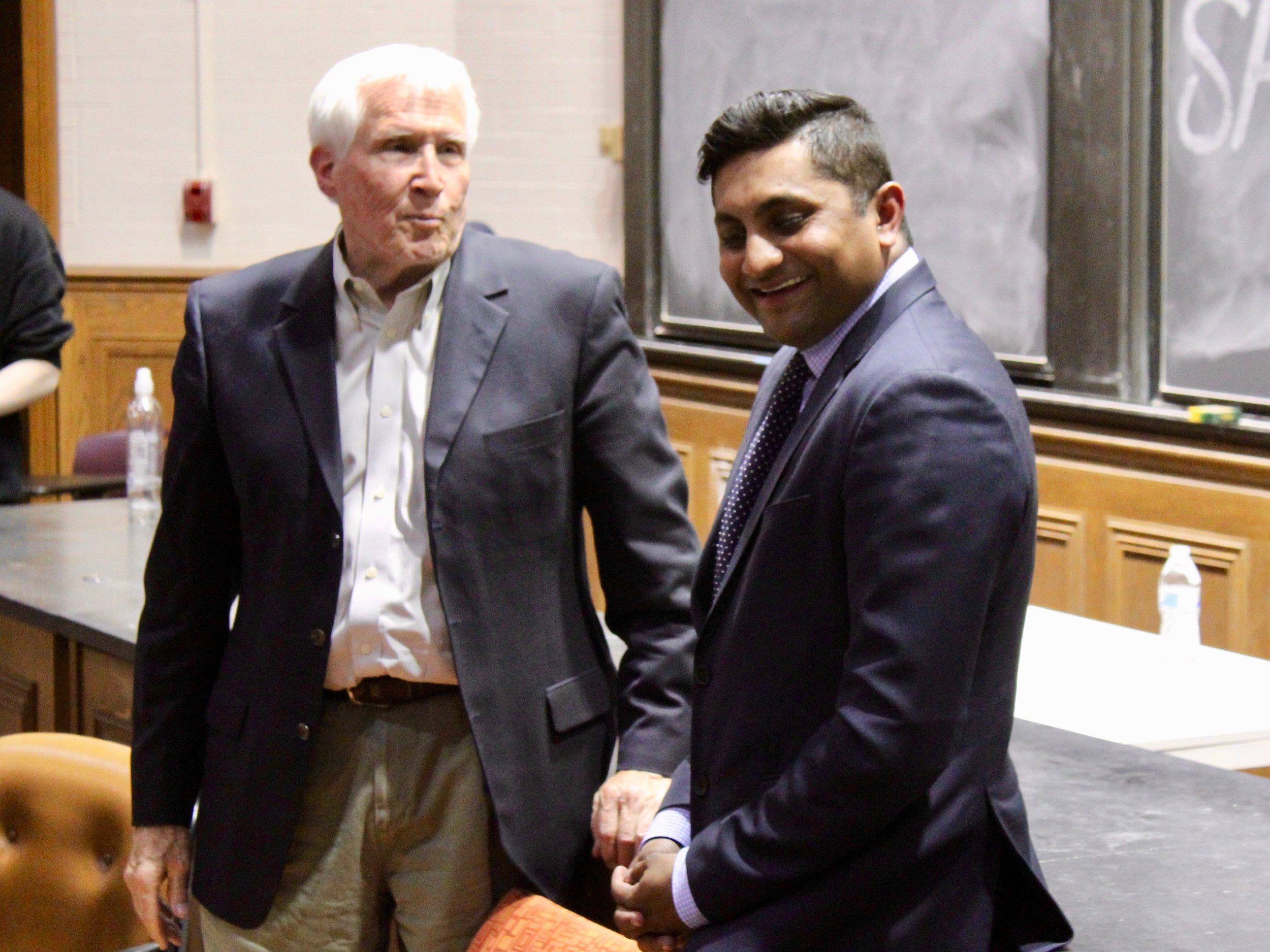 University of Chicago economist Allen Sanderson and Alderman Ameya Pawar talk after their debate in May. (One Illinois/Ted Cox)