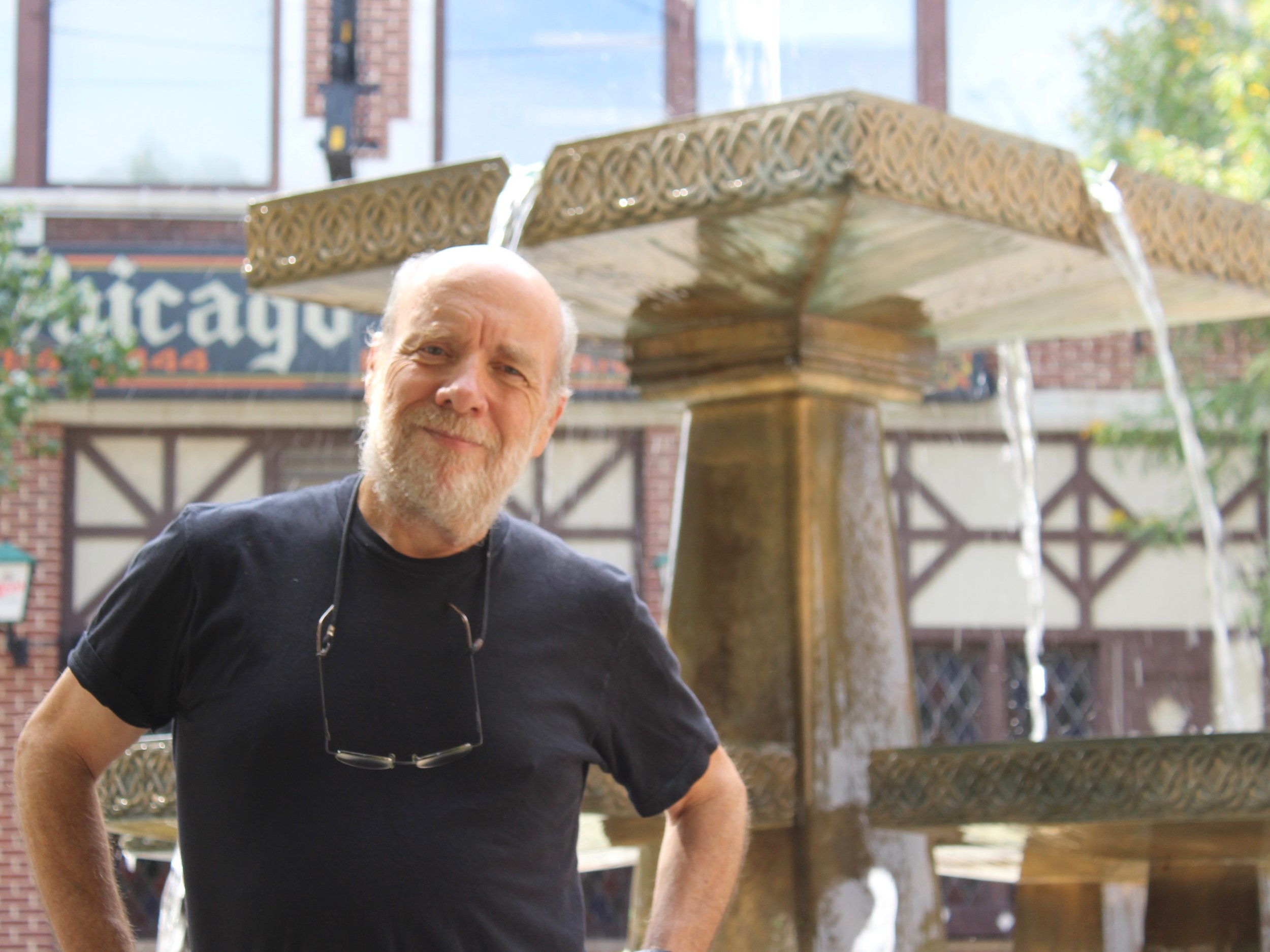 Mike Lenehan of Blue Beginning stands in front of the public fountain in Chicago's Lincoln Square. (One Illinois/Ted Cox)