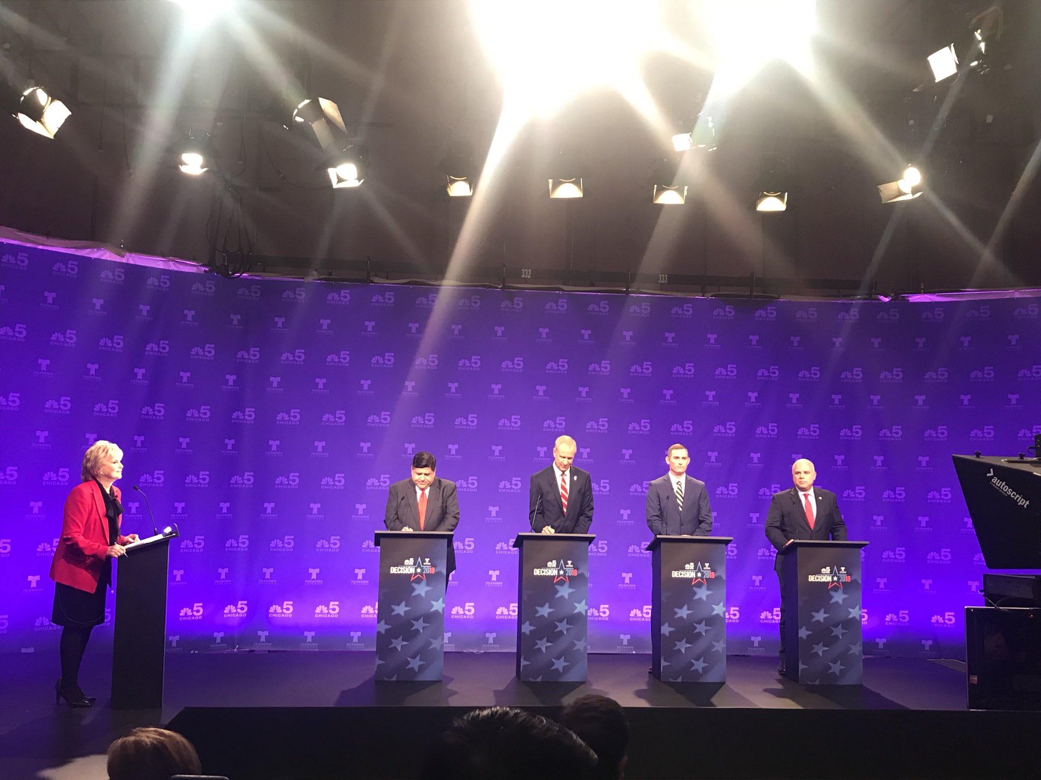 "NBC's Carol Marin, J.B. Pritzker, Gov. Bruce Rauner, Grayson ""Kash"" Jackson, and state Rep. Sam McCann take the stage for Thursday's televised debate. (Twitter/Christian Mitchell)"