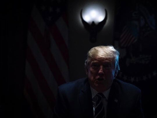 President Trump as the lights were inadvertently turned off during a speech at the White House earlier this year. (Twitter)