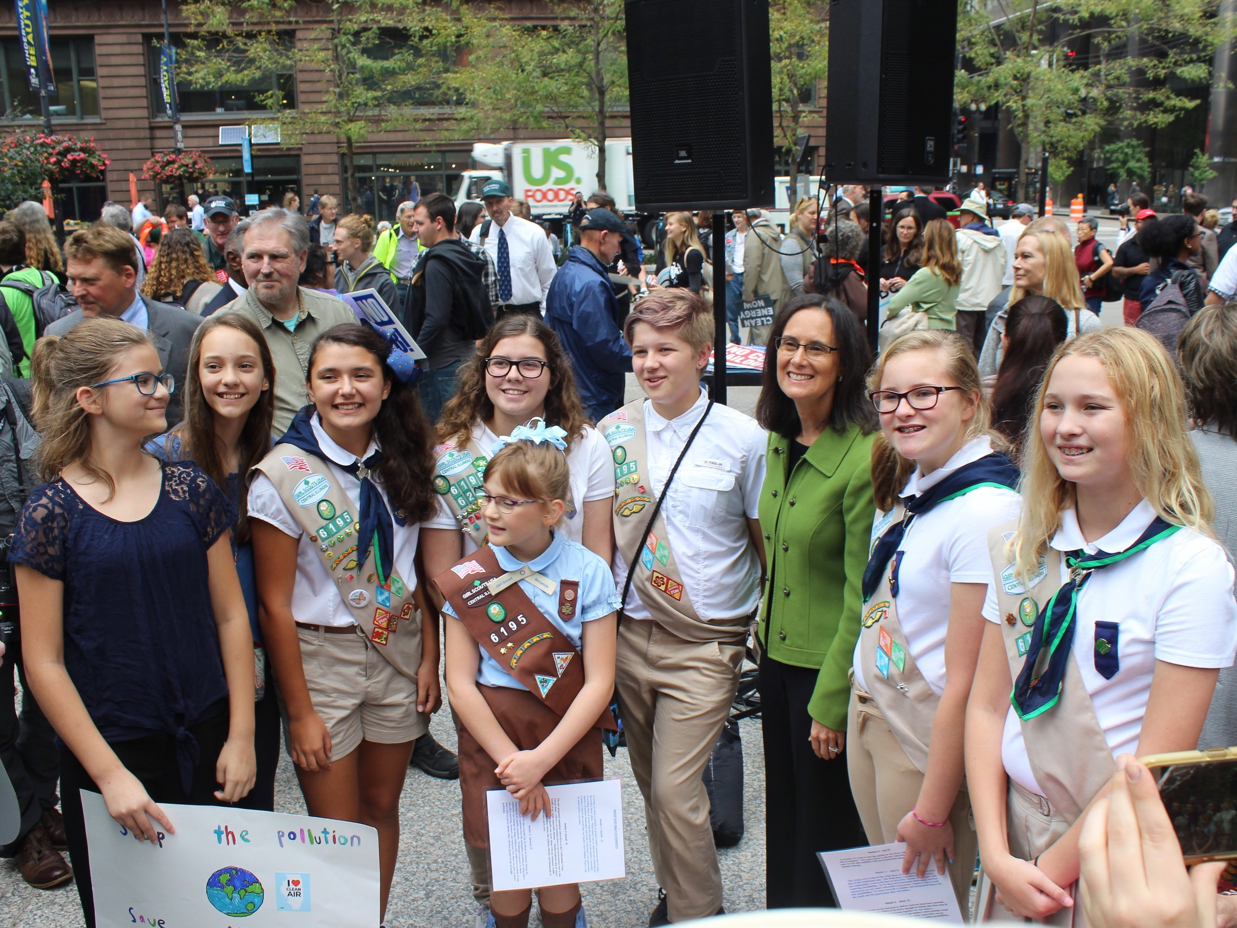 Members of Pleasant Plains Girl Scout Troop 6195 pose with Attorney General Madigan after Monday's protest in Chicago. (One Illinois/Ted Cox)