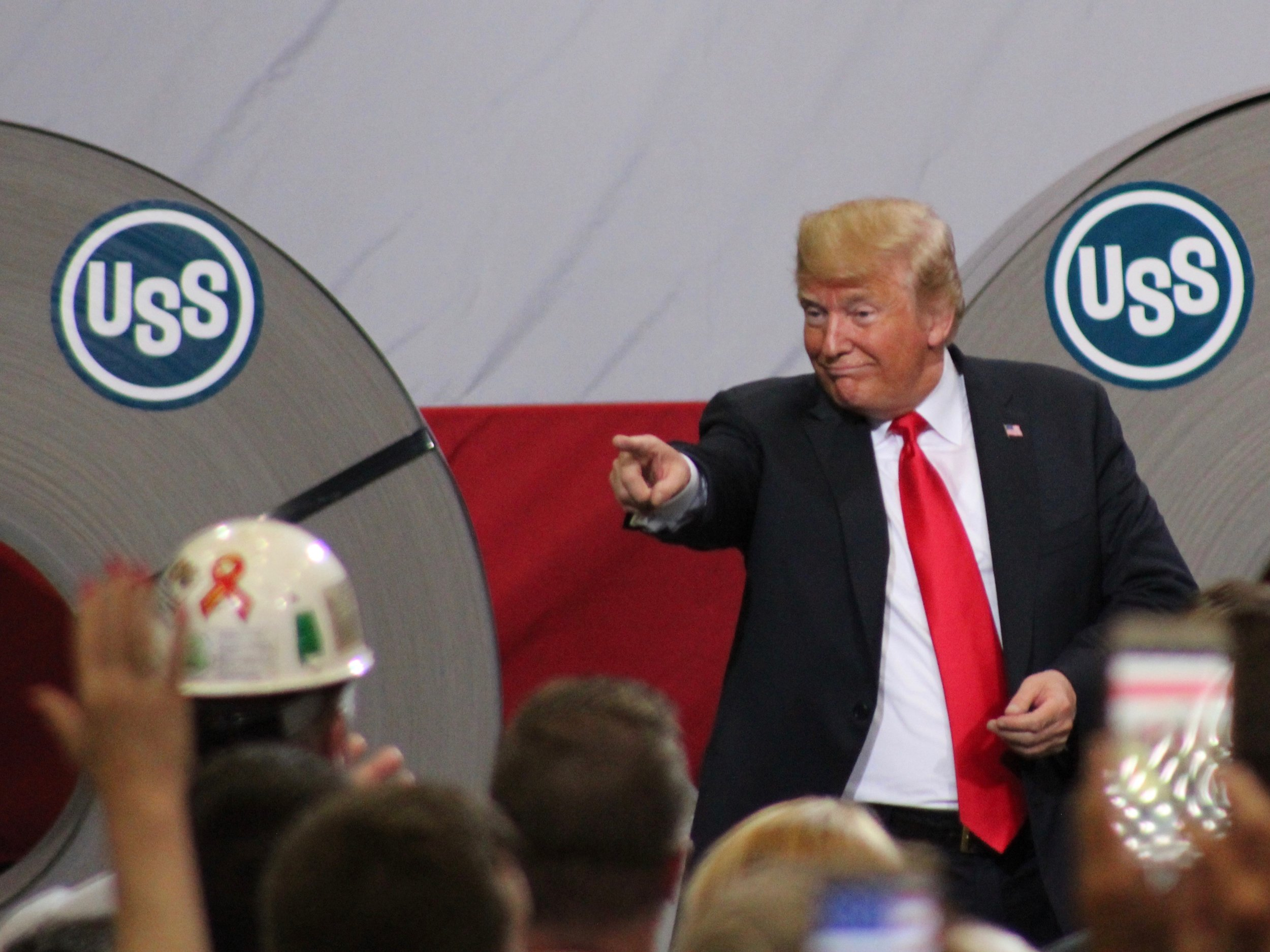 "President Trump at the U.S. Steel Granite City Works this summer, where he pointed to media reporters in the back and called them ""fake news."" (One Illinois/Ted Cox)"