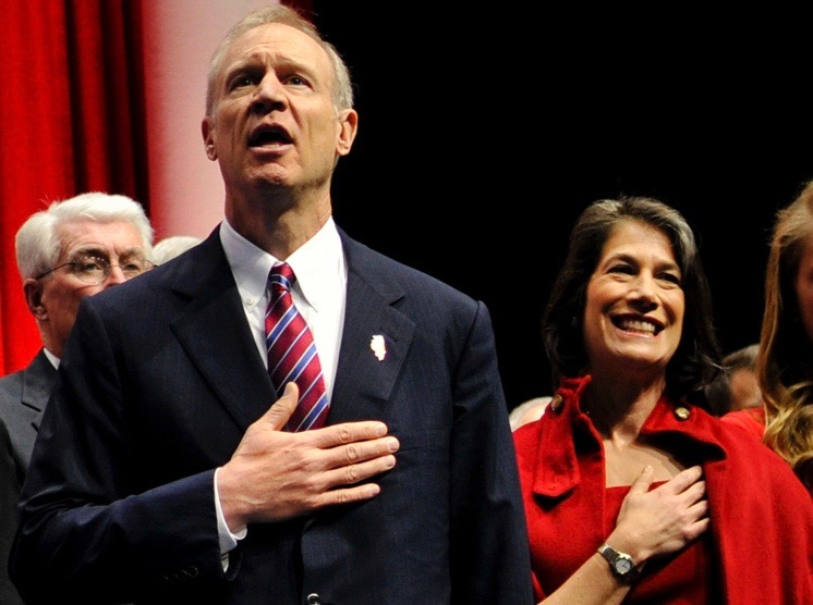 Gov. Bruce Rauner and his wife, Diana, sing the national anthem at an event. (U.S. Air National Guard/Staff Sgt. Lealan Buchrer)
