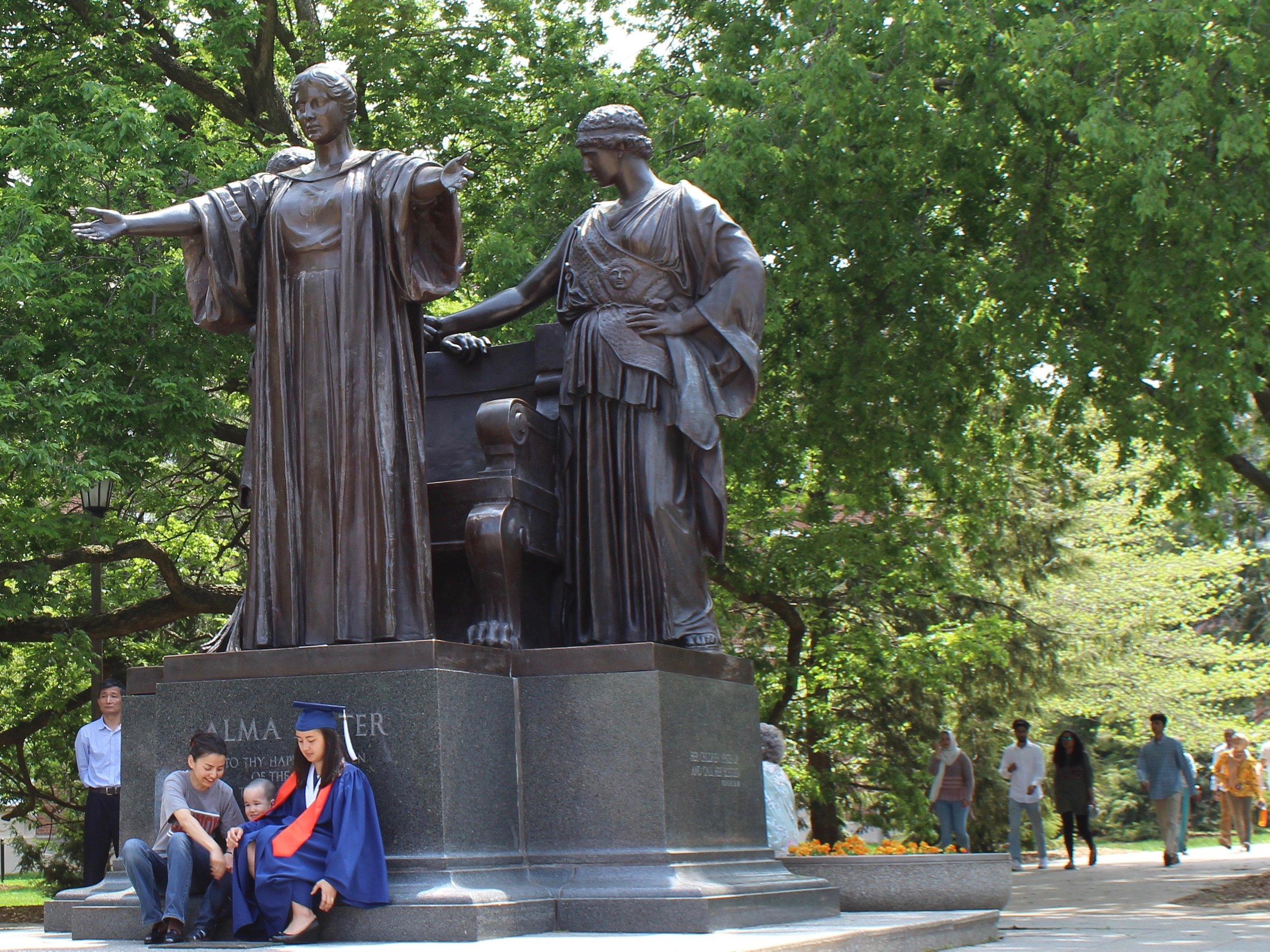 A new graduate and her family park in front of the University of Illinois Alma Mater last May. (One Illinois/Ted Cox)