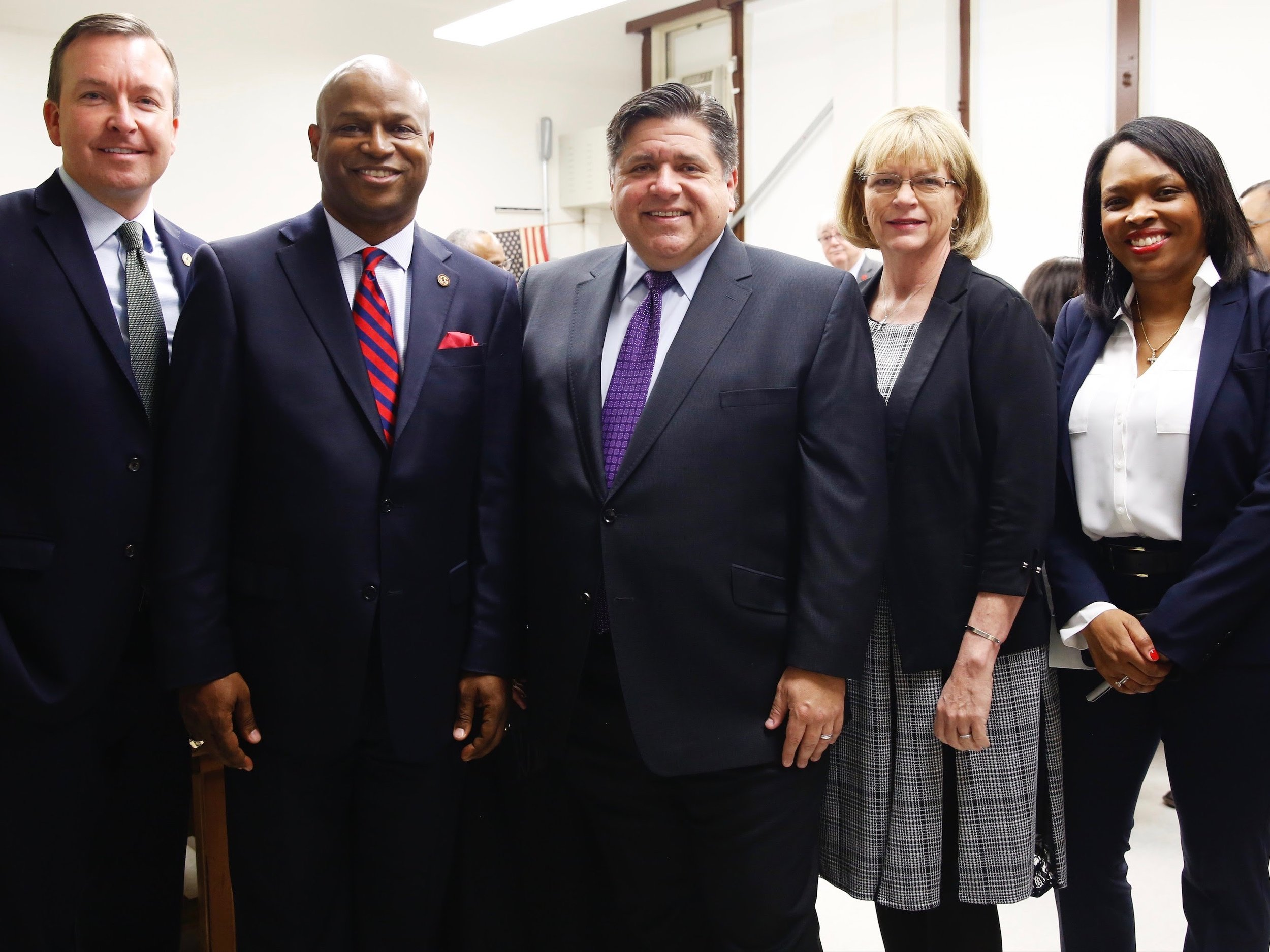 Gov.-elect Pritzker (center) with the leaders of his education transition committee: state Sen. Andy Manar, state Rep. Chris Welch, IEA President Kathi Griffin, and CPS CEO Janice Jackson. (Pritzker Transition Press Team)