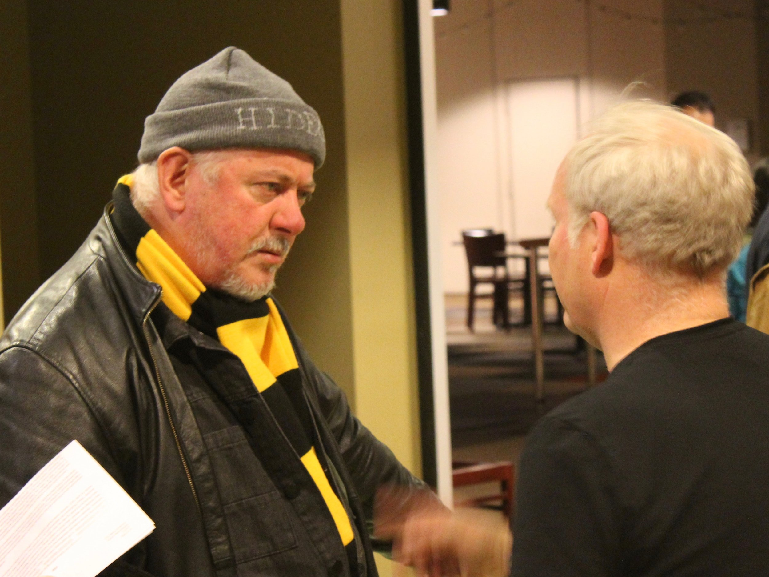 Jon Langford talks with Hideout owner Tim Tuten at Thursday's CIVL announcement. (One Illinois/Ted Cox)