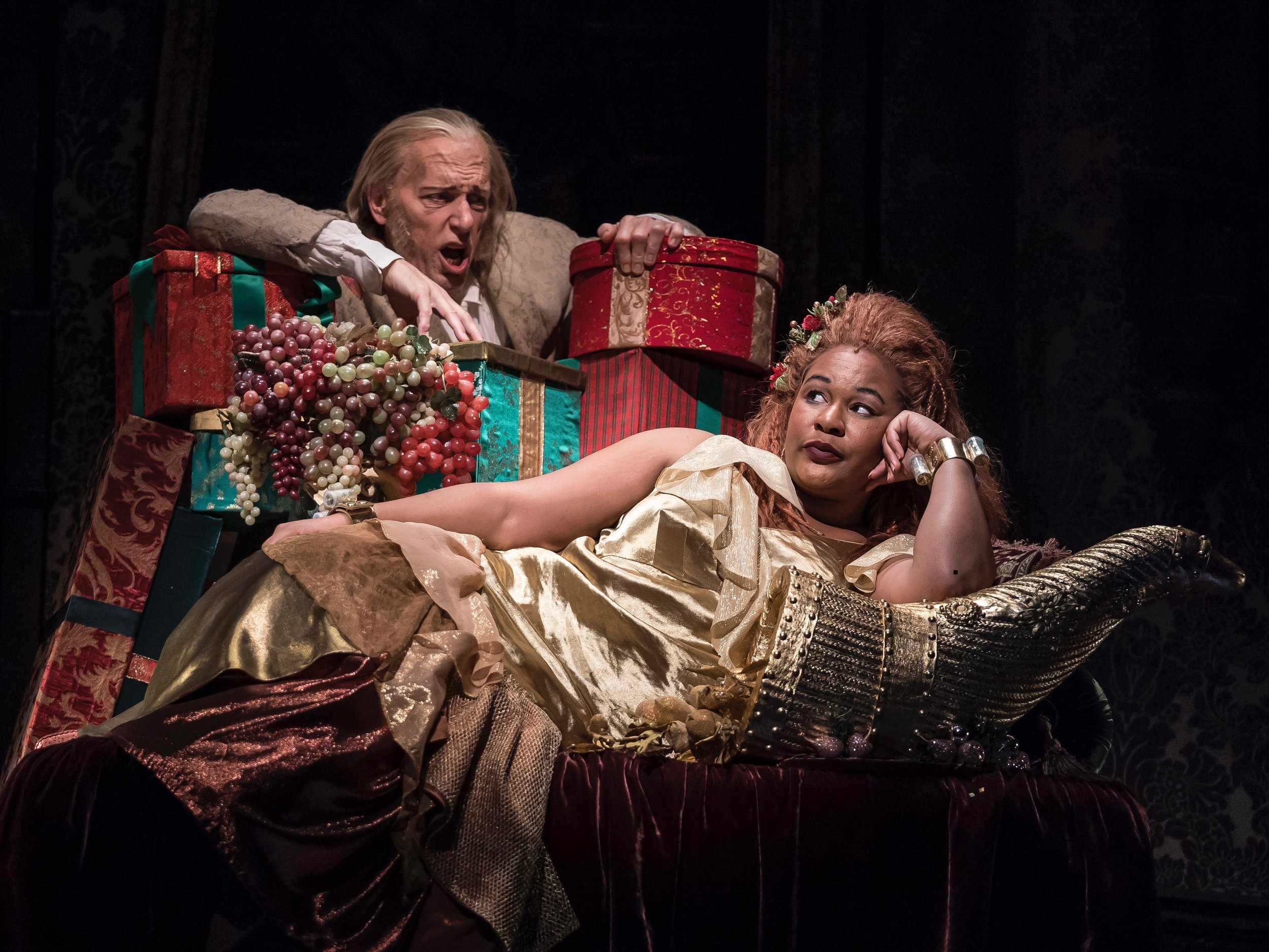 "Larry Yando is Scrooge and Jasmine Bracey is the Ghost of Christmas Present in ""A Christmas Carol."" (Goodman Theater)"