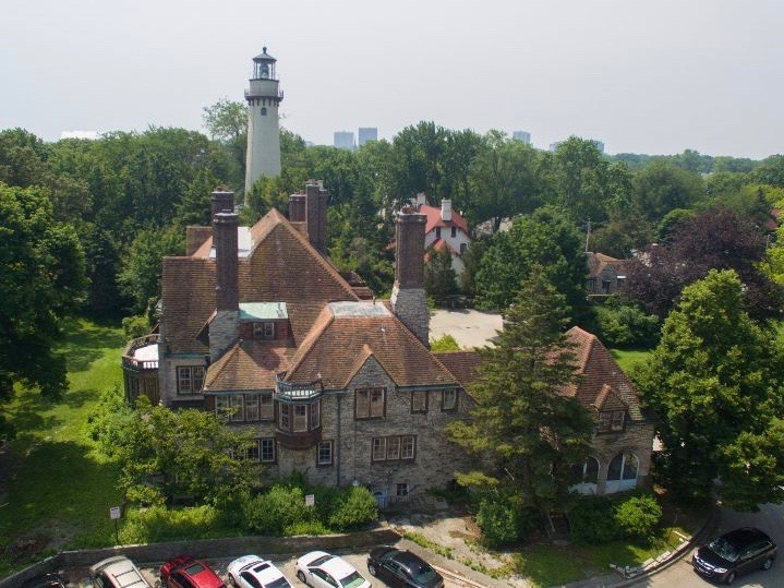 Evanston's Harley Clarke Mansion will be preserved, alongside the city's signature lighthouse on the Lake Michigan shore — at least for now. (Wikimedia Commons/Cwasserburg)