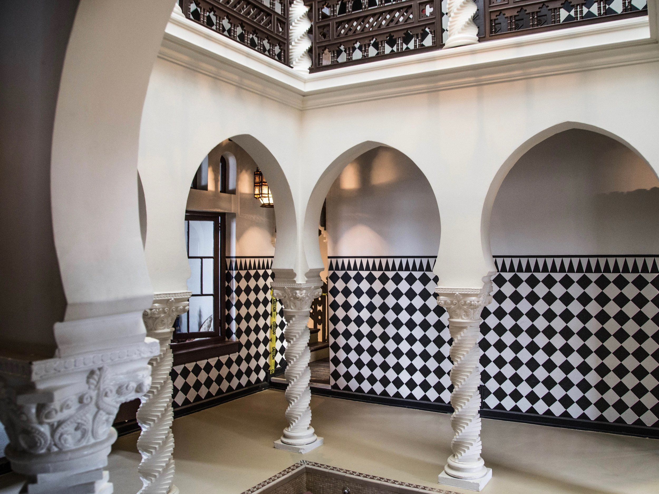 The indoor courtyard of the Villa Kathrine has a marble mosaic reflecting pool and a second-floor balcony. (One Illinois/Zachary Sigelko)