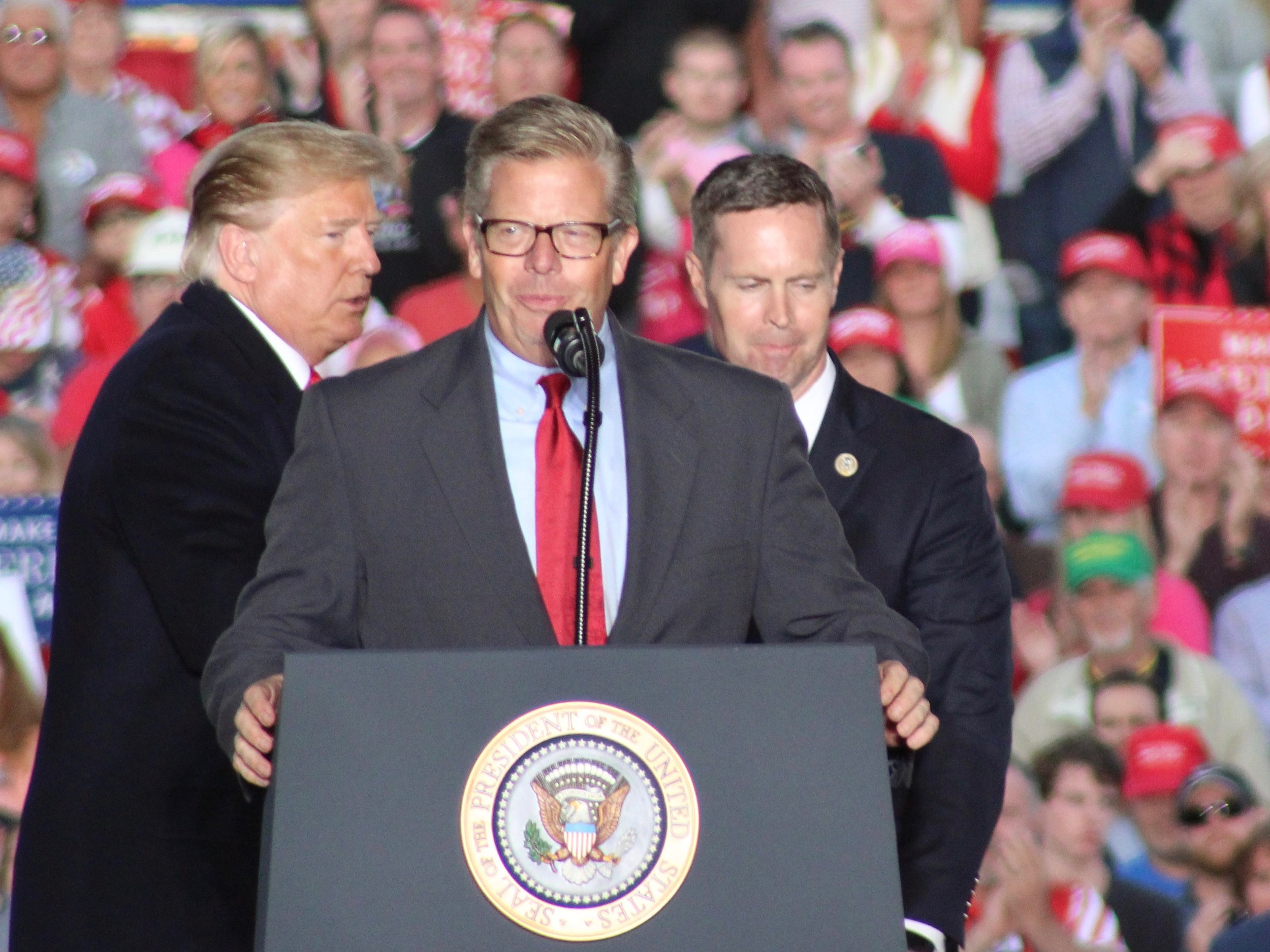 President Donald Trump with Congressmen Randy Hultgren and Rodney Davis at a campaign rally in Murphysboro the weekend before the midterms: Hultgren paid the price for unwavering support for the president, but Davis survived in a district Trump won more comfortably in 2016. (One Illinois/Ted Cox)