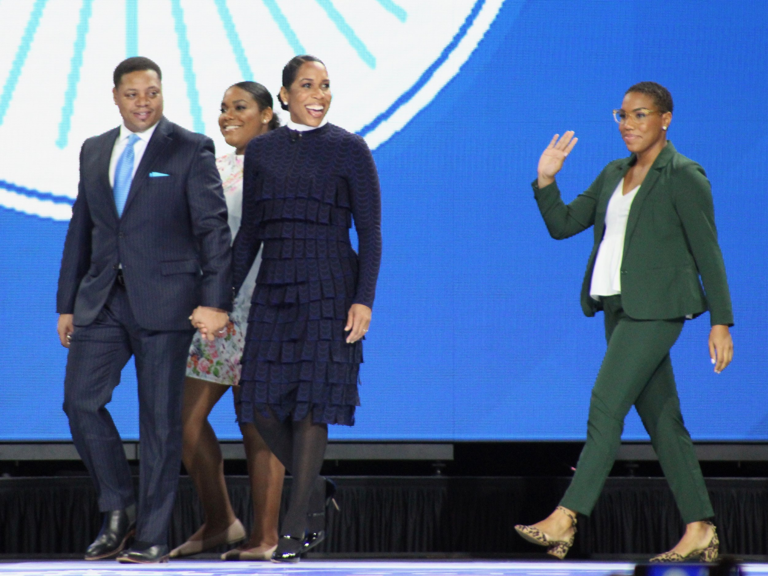 Holding the hand of fiancee Bryon Echols, Juliana Stratton takes the stage at the Illinois inauguration ceremony Monday along with two of her daughters. (One Illinois/Ted Cox)