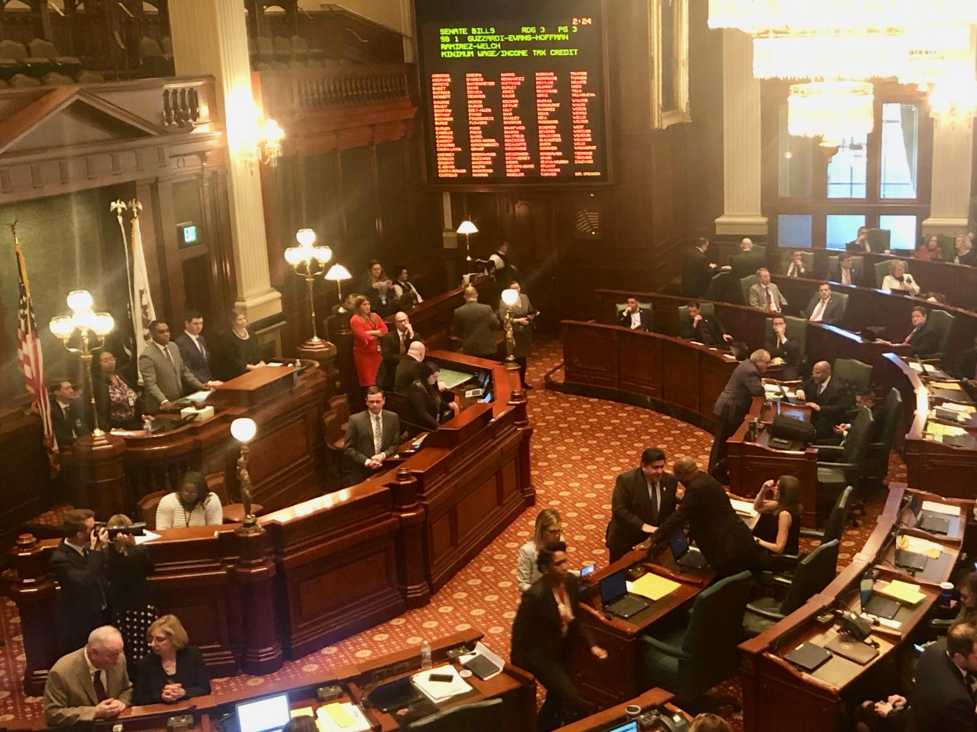 Gov. Pritzker lobbies on the House floor before the vote on the minimum wage. (Twitter/Andrea Kluger)
