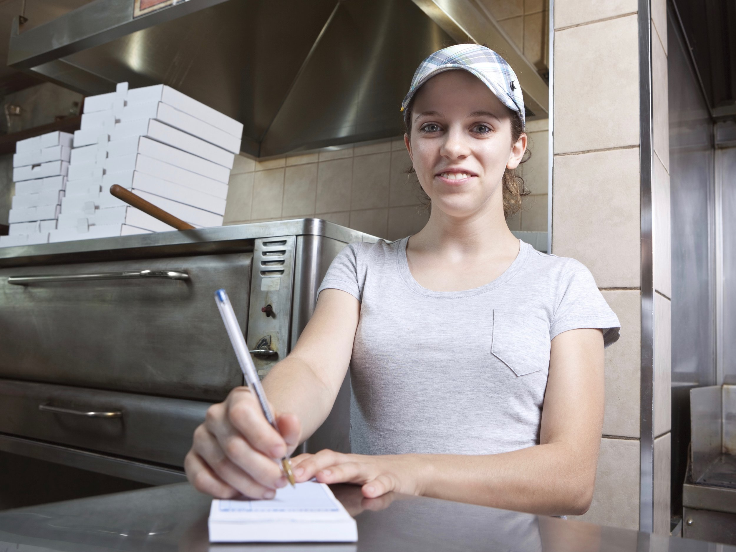 A new study finds a higher minimum wage hikes pay across the board for low-wage workers, most of whom are women. (Shutterstock)