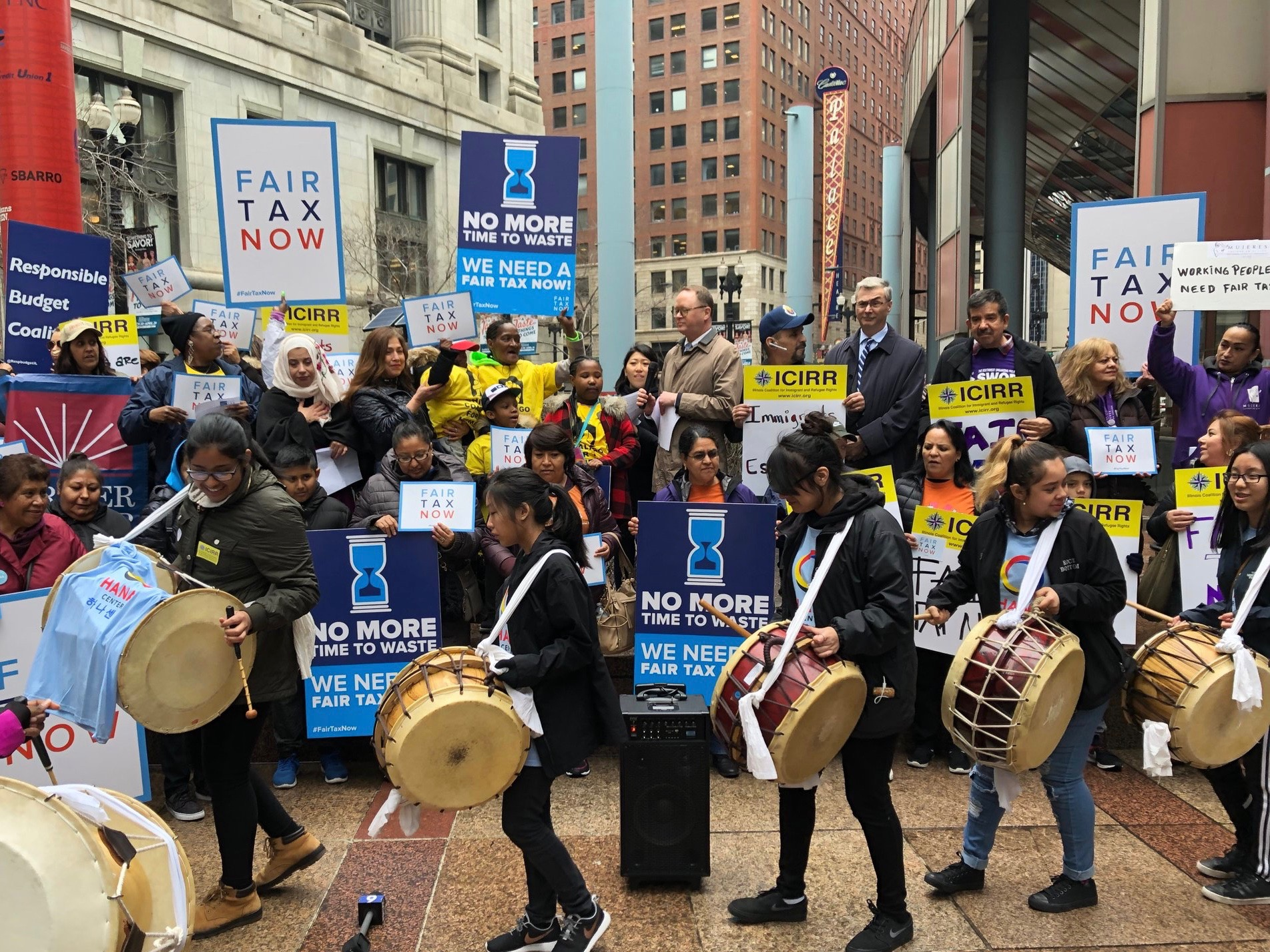 """Union groups and immigration advocates rally outside the Thompson Center in Chicago this week in support of Gov. Pritzker's """"fair tax."""" (Twitter/SEIU Healthcare)"""