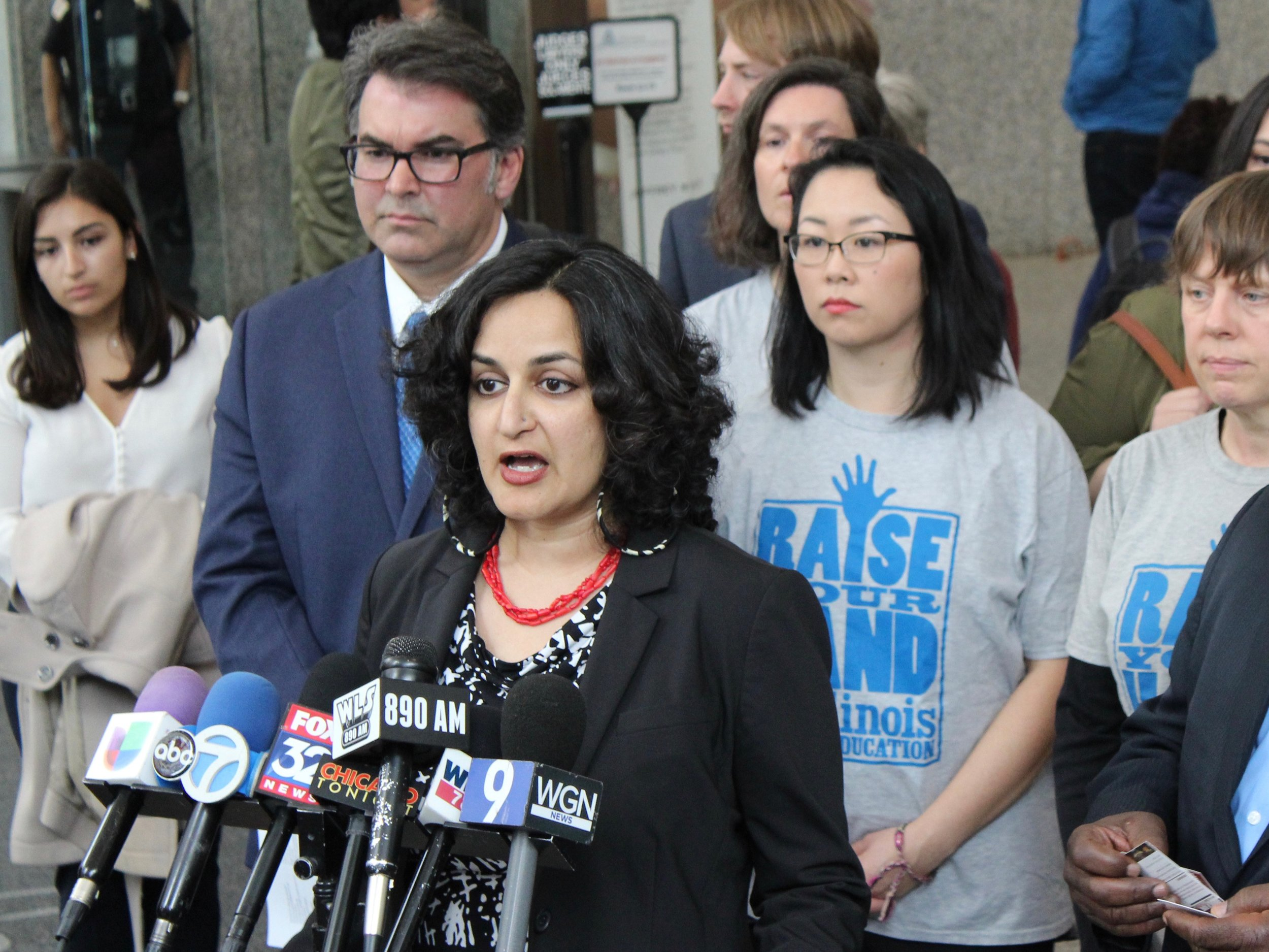 Amisha Patel, executive director of the Grassroots Collaborative, discusses the suit filed Wednesday against Chicago's TIF program at the Daley Center. (One Illinois/Ted Cox)