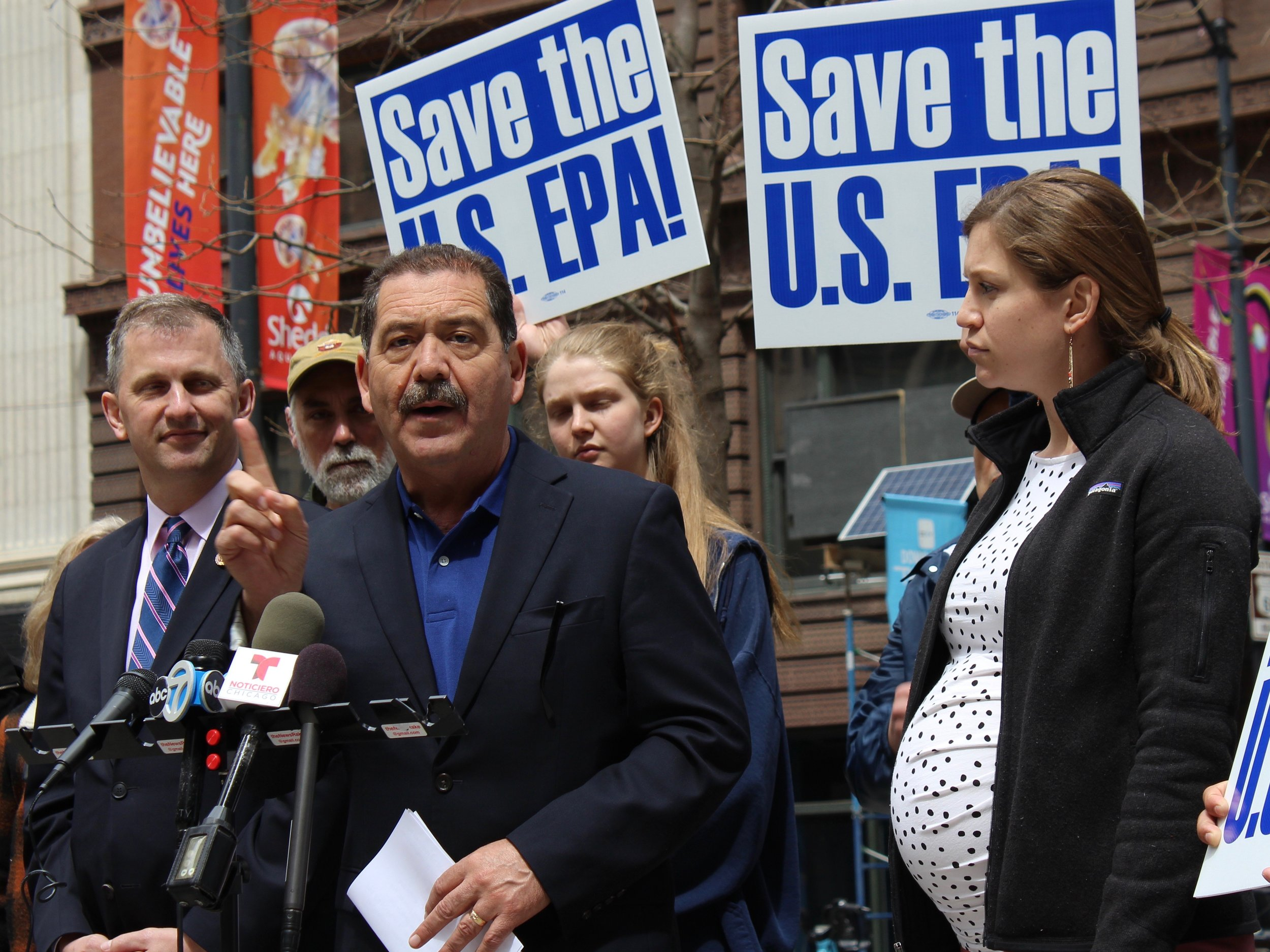 "Flanked by congressional colleague Sean Casten and Kady McFadden of the Illinois Sierra Club, Rep. Jesus ""Chuy"" Garcia decries budget cuts he said would ""decimate"" the EPA at a rally in Chicago on Tuesday. (One Illinois/Ted Cox)"