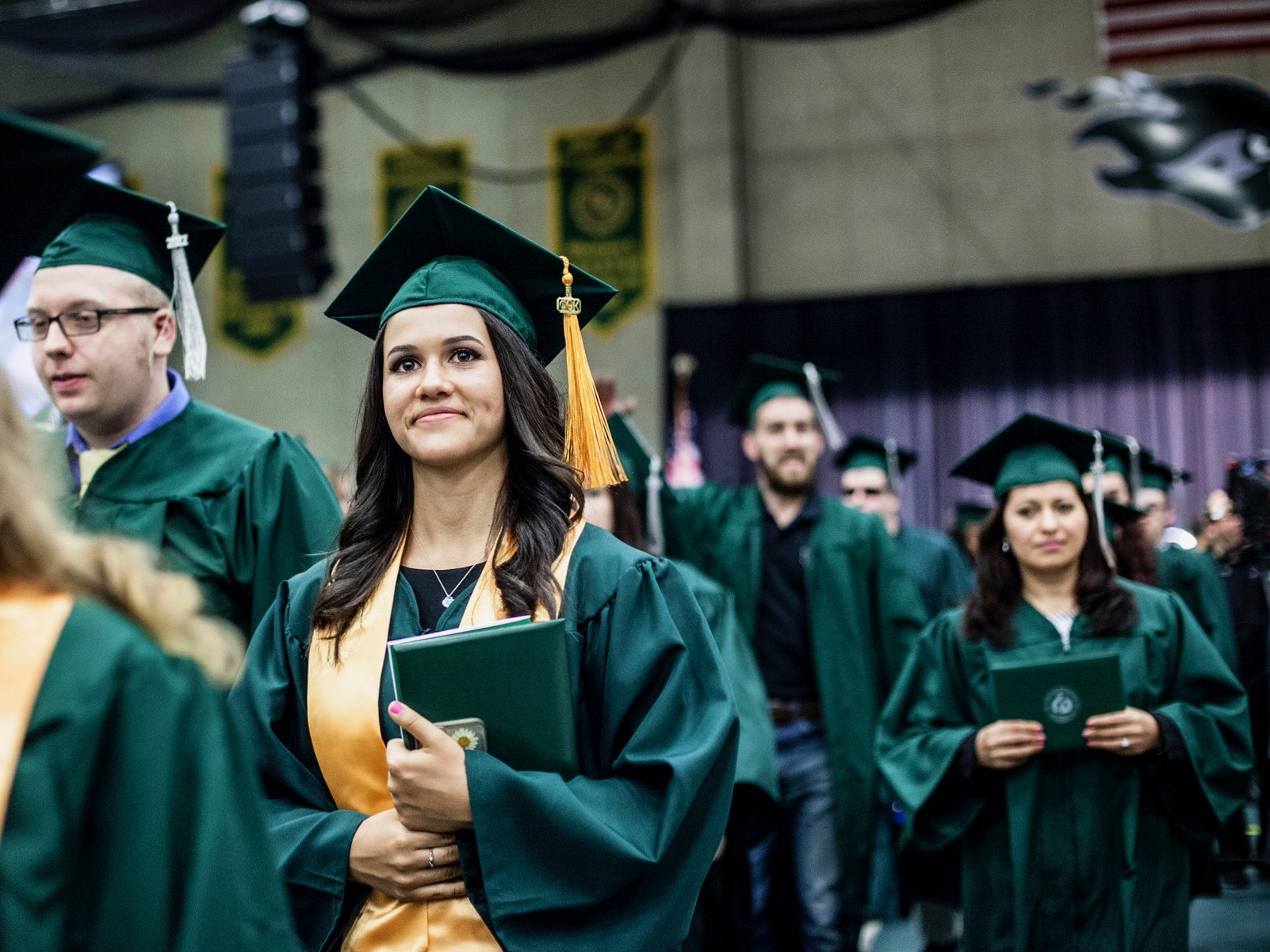 Graduates collect their diplomas at the 50th College of DuPage commencement two years ago. (Flickr/College of DuPage Newsroom)