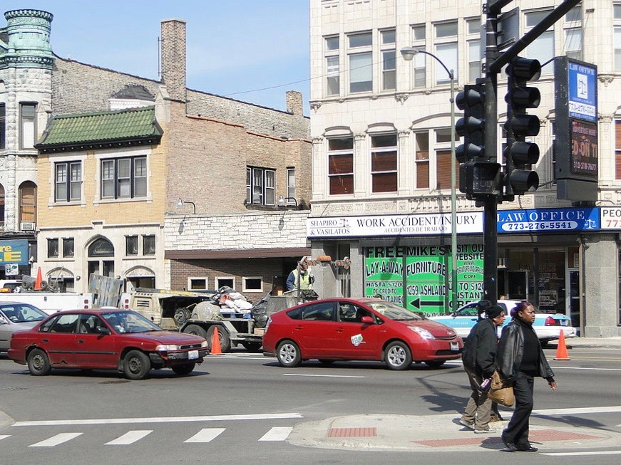 Pedestrians walk in Chicago's West Town neighborhood at Division Street and Milwaukee Avenue. (Wikimedia Commons/Adam Jones)