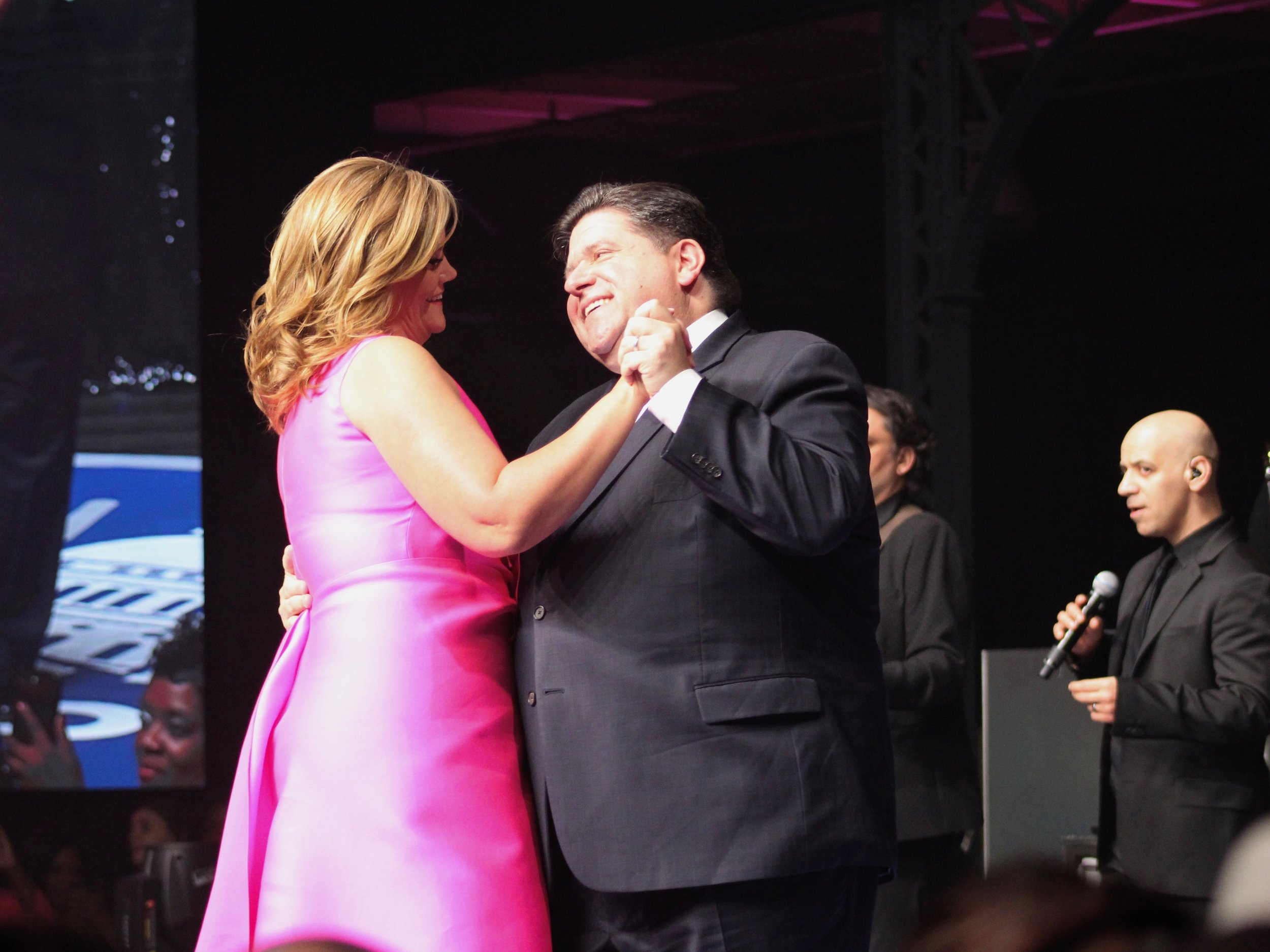 "M.K. and Gov. J.B. Pritzker have their first dance as the state's first couple to Marvin Gaye's ""How Sweet It Is"" at their inaugural celebration in January. (One Illinois/Ted Cox)"