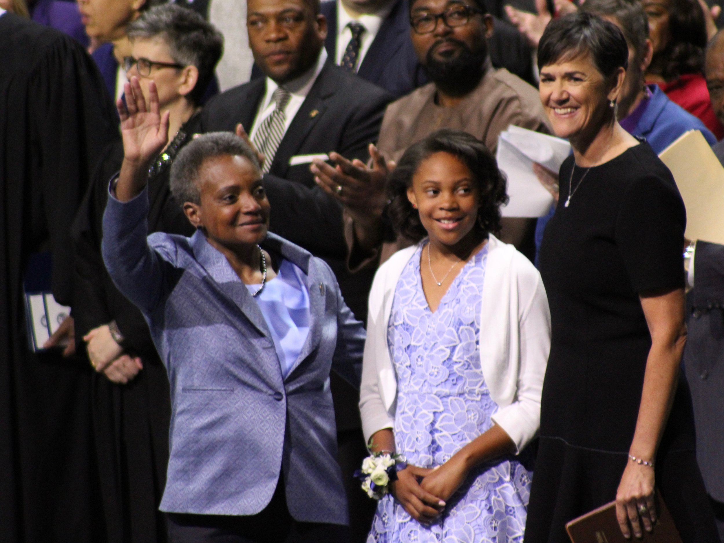 Chicago's new first family: Mayor Lightfoot and her wife, Amy Eshleman, greet the crowd along with their daughter, Vivian. (One Illinois/Ted Cox)
