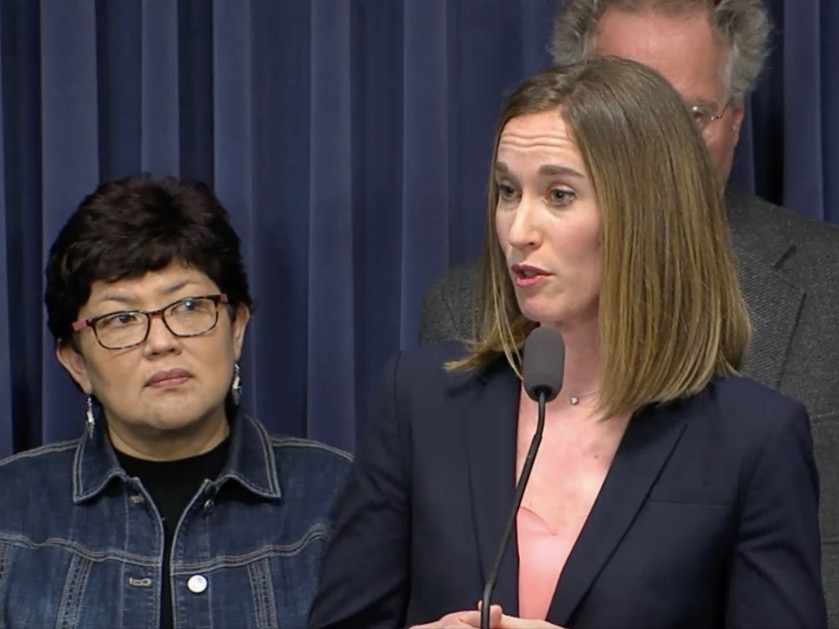 Backed by Imelda Salazar of Chicago, Allison Clements of the Illinois Housing Council makes a case for increased funding for affordable housing. (Blue Room Stream)