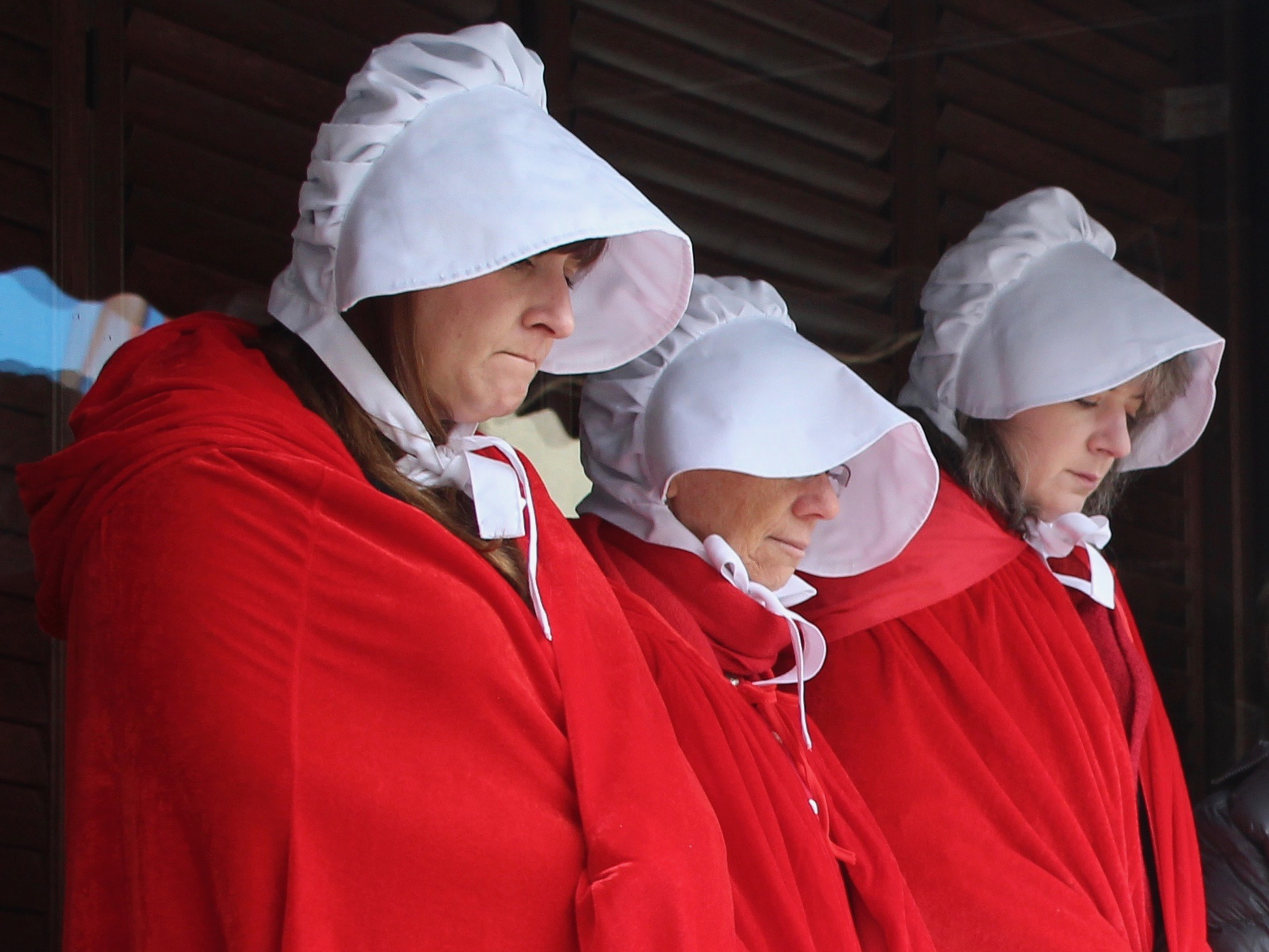 "Planned Parenthood protesters wear ""A Handmaid's Tale"" outfits at an event late last year. (One Illinois/Ted Cox)"