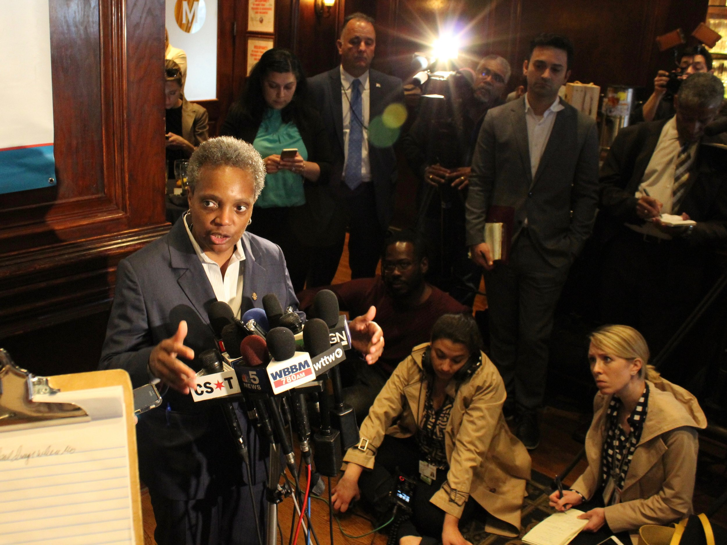 Mayor Lori Lightfoot talks with reporters after her appearance Tuesday at the City Club of Chicago luncheon at Maggiano's Banquets. (One Illinois/Ted Cox)