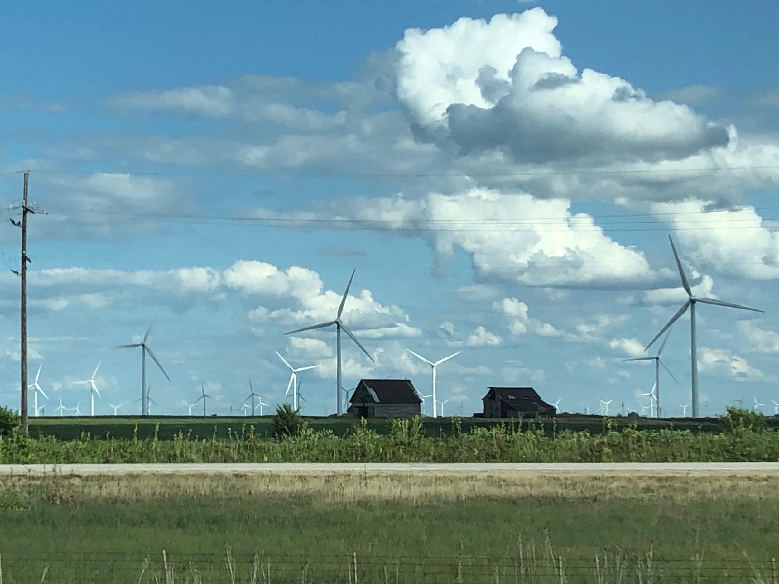Wind farms and farms coexist in Illinois. (One Illinois/Ted Cox)