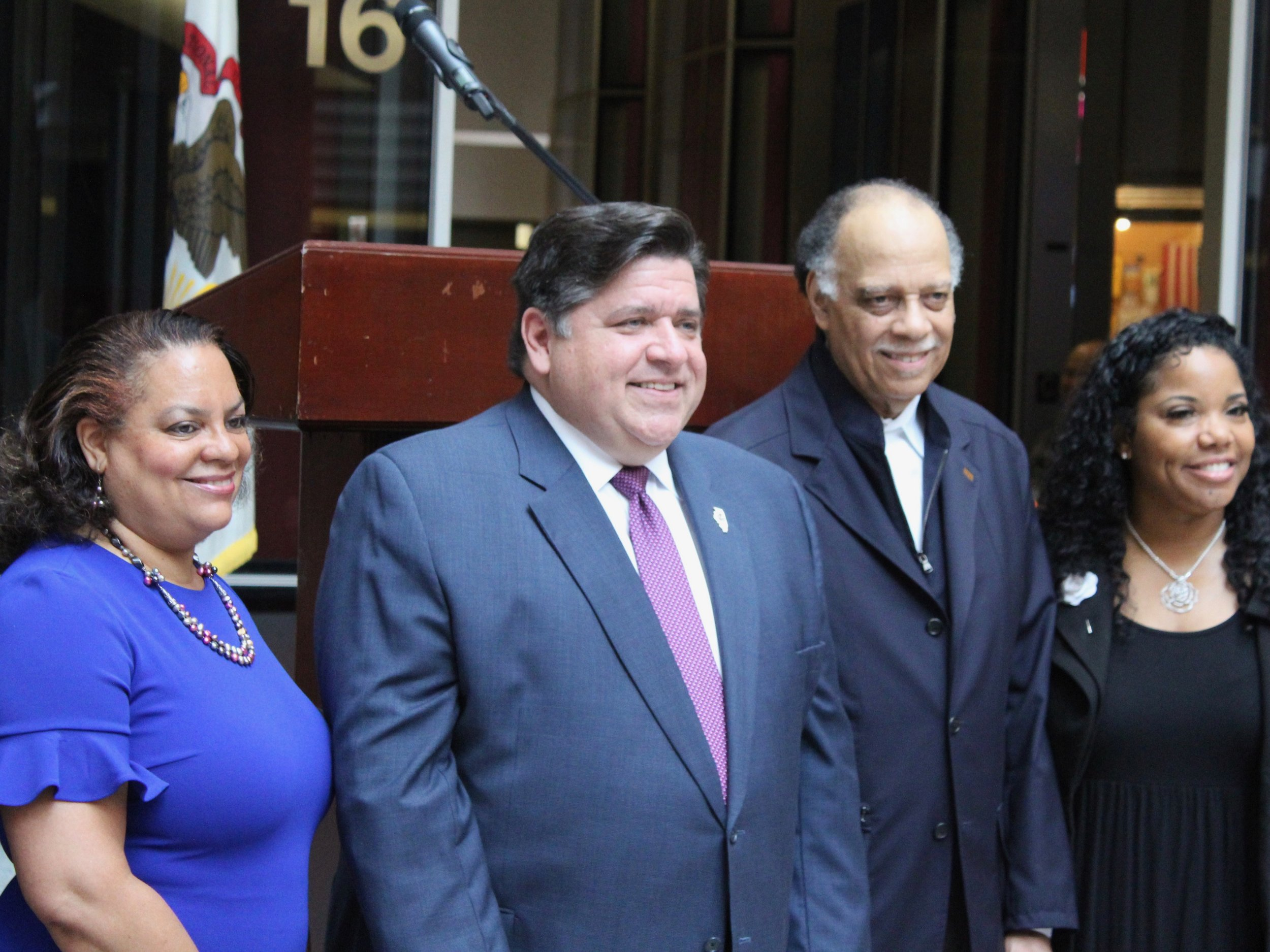Gov. Pritzker poses with Juneteenth honorees Michelle Duster, Haki Madhubuti, and Myiti Sengstacke-Rice at Wednesday's ceremony. (One Illinois/Ted Cox)