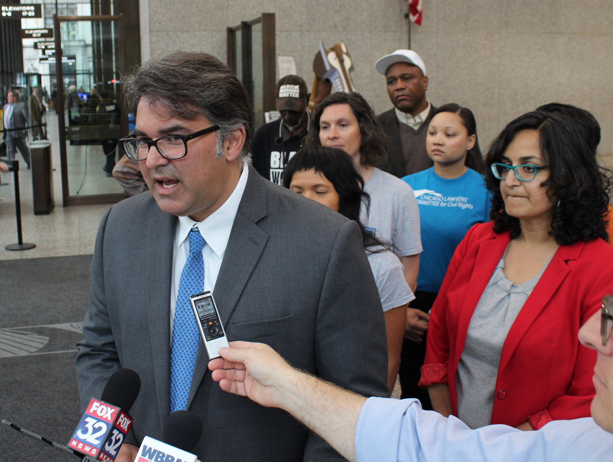 Backed by Amisha Patel of the Grassroots Collaborative (right), lawyer Aneel Chablani lays out the legal case against the Lincoln Yards TIF district. (One Illinois/Ted Cox)