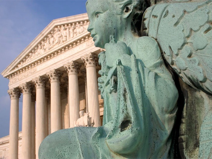 The U.S. Supreme Court found the scales of justice tipping back and forth in a pair of controversial rulings on Thursday. (Flickr/Justin)