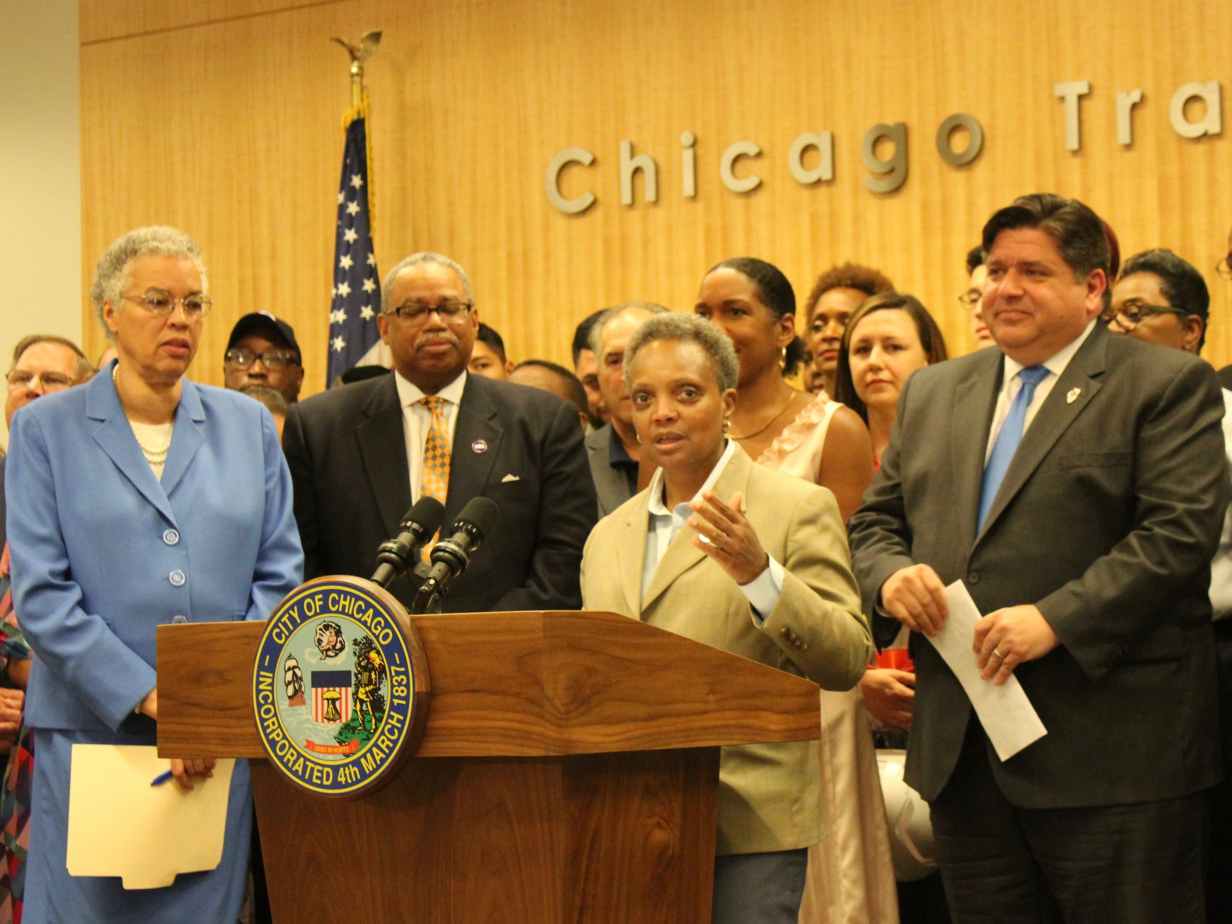 With Cook County Board President Toni Preckwinkle and CTA President Dorval Carter looking on, Chicago Mayor Lori Lightfoot and Gov. J.B. Pritzker discuss how the Rebuild Illinois capital plan will improve mass transit. (One Illinois/Ted Cox)