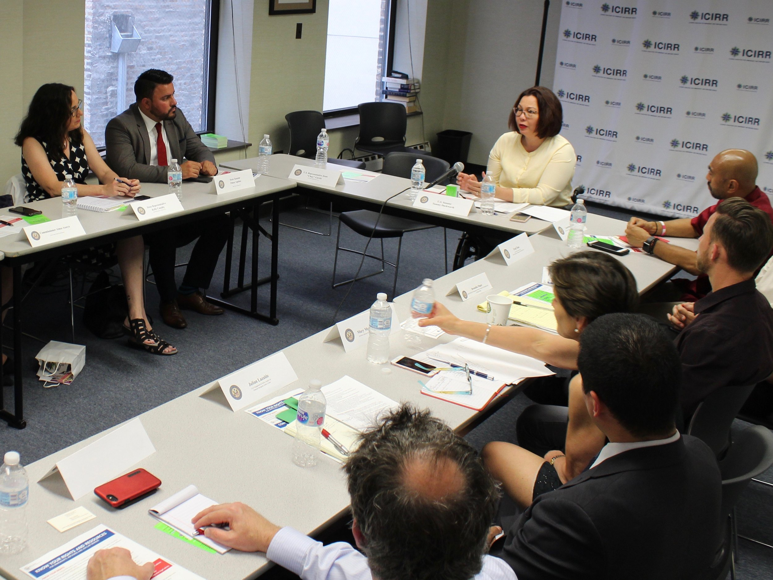 U.S. Sen. Tammy Duckworth holds a roundtable discussion with immigrant groups and state Rep. Kelly Cassidy and state Sen. Omar Aquino (left) in Chicago. (One Illinois/Ted Cox)