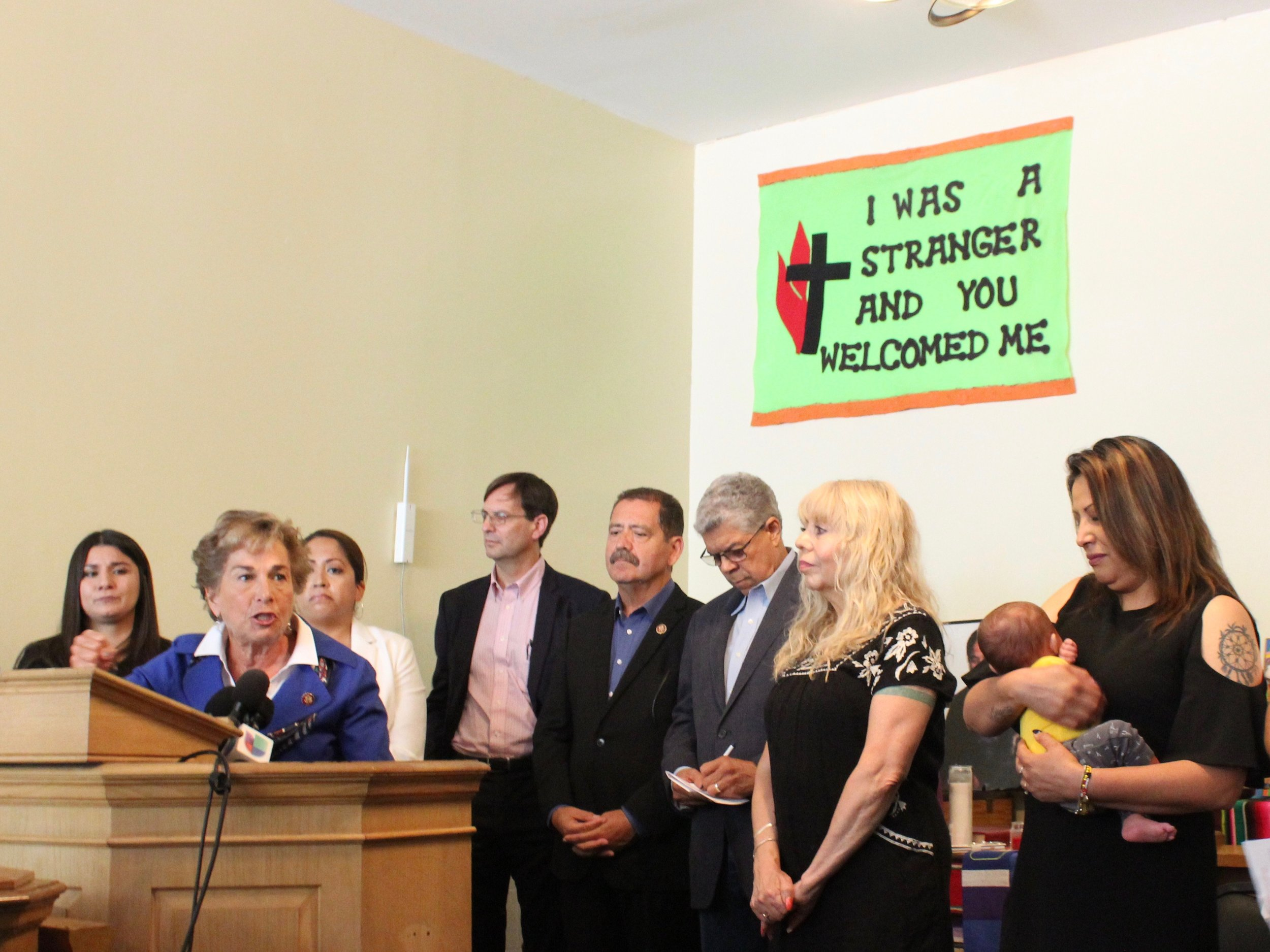 "U.S. Rep. Jan Schakowsky speaks out against the Trump administration's immigration policy, backed by U.S. Rep. Jesus ""Chuy"" Garcia and Chicago Alderman Roberto Maldonado (center), with Pastor Emma Lozano and Francisca Lino, holding her grandson, at right. (One Illinois/Ted Cox)"