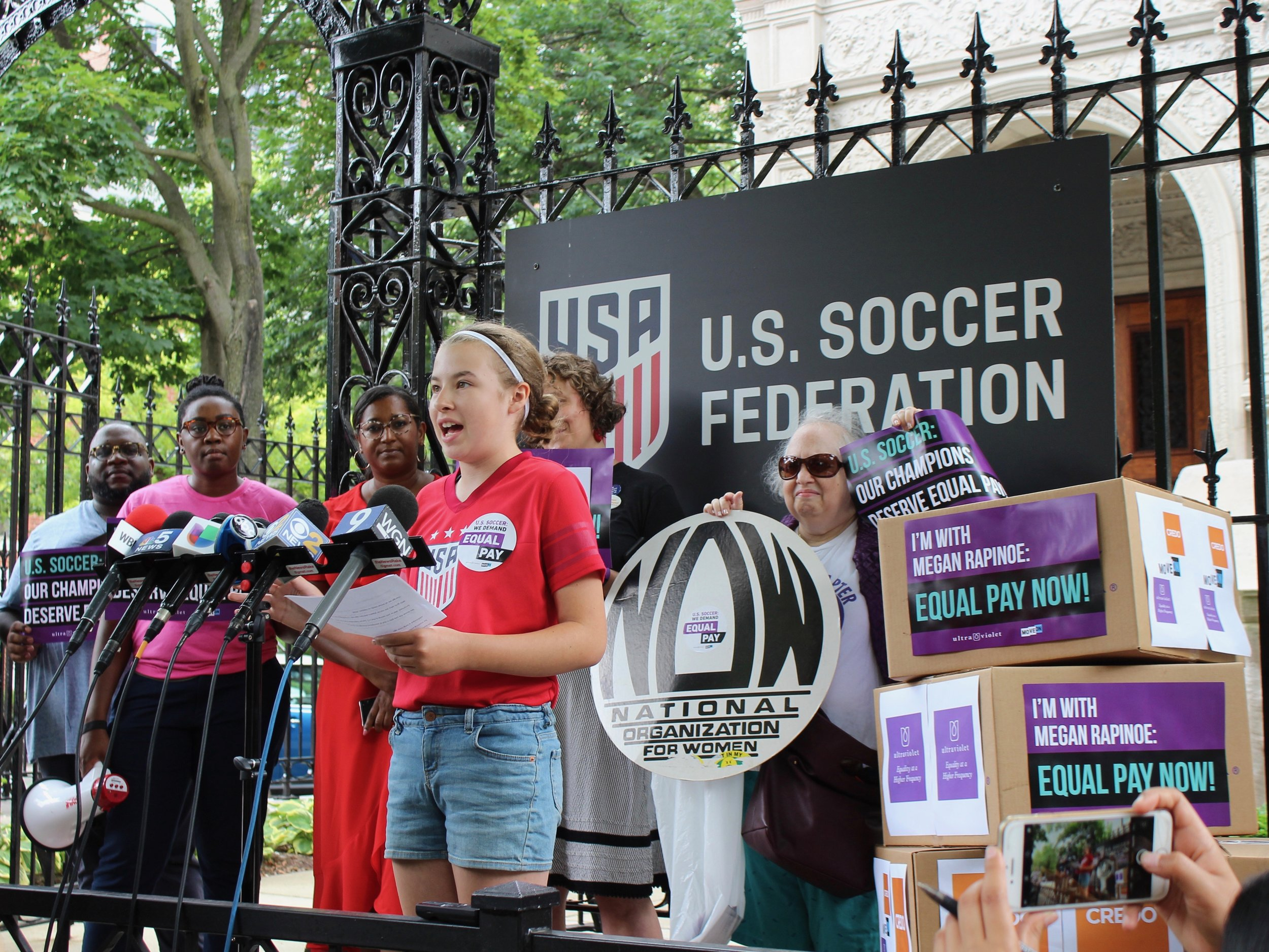 Greta Lindall, a seventh-grade soccer player at Skinner North Classical School in Chicago, speaks out in support of equal pay for the U.S. Women's National Team outside the U.S. Soccer Federation. (One Illinois/Ted Cox)