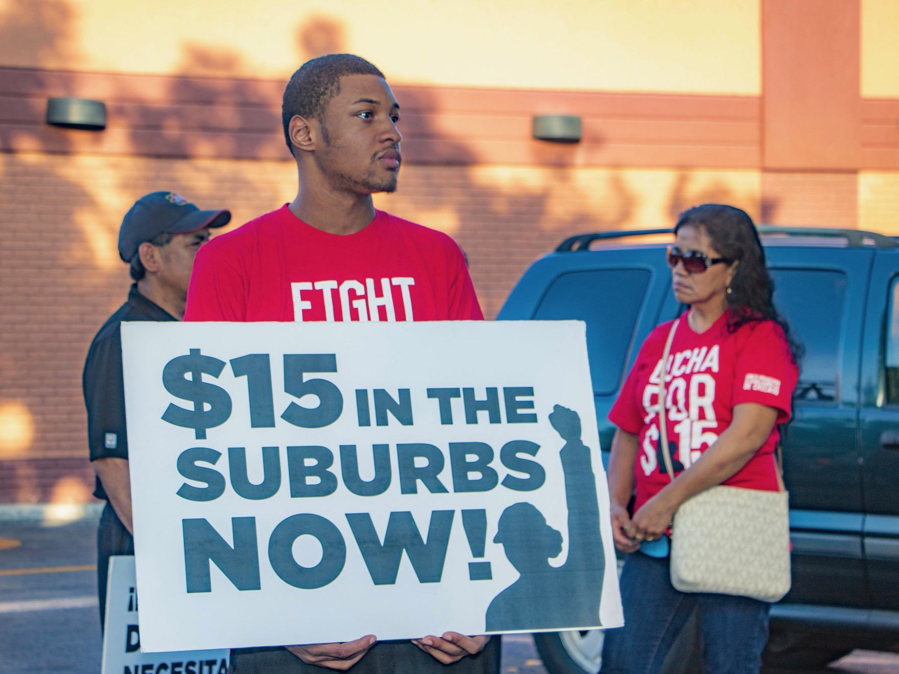 Demonstrators lobby for a $15-an-hour minimum wage in Oak Park in 2016. (Flickr/Bob Sampson)