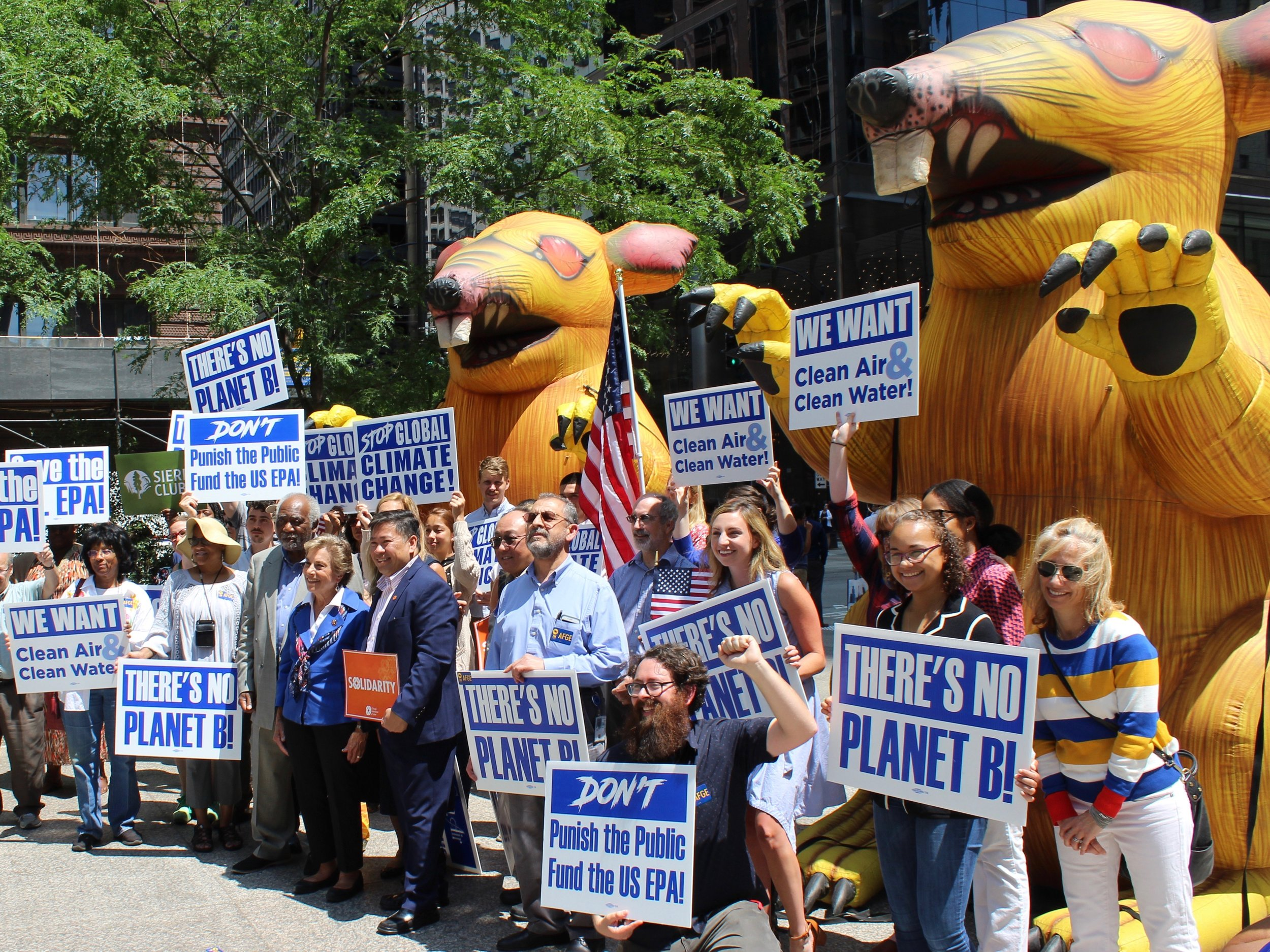 A pair of Scabby the Rat inflatable figures loom over a protest staged by EPA workers earlier this year in Chicago. (One Illinois/Ted Cox)