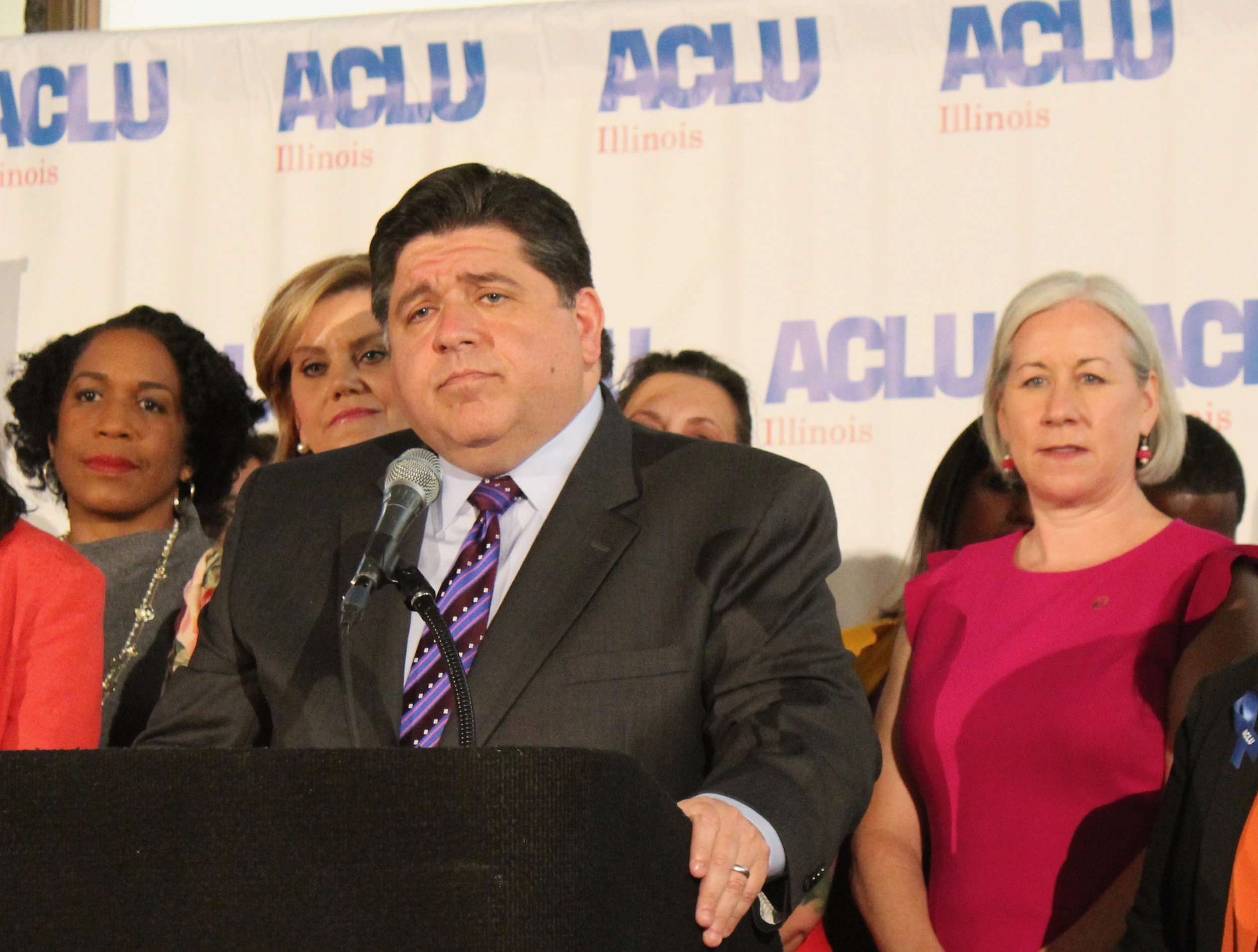 Gov. Pritzker and Planned Parenthood of Illinois President Jennifer Welch (right) speak at a bill-signing ceremony for the Reproductive Health Act earlier this year. (One Illinois/Ted Cox)