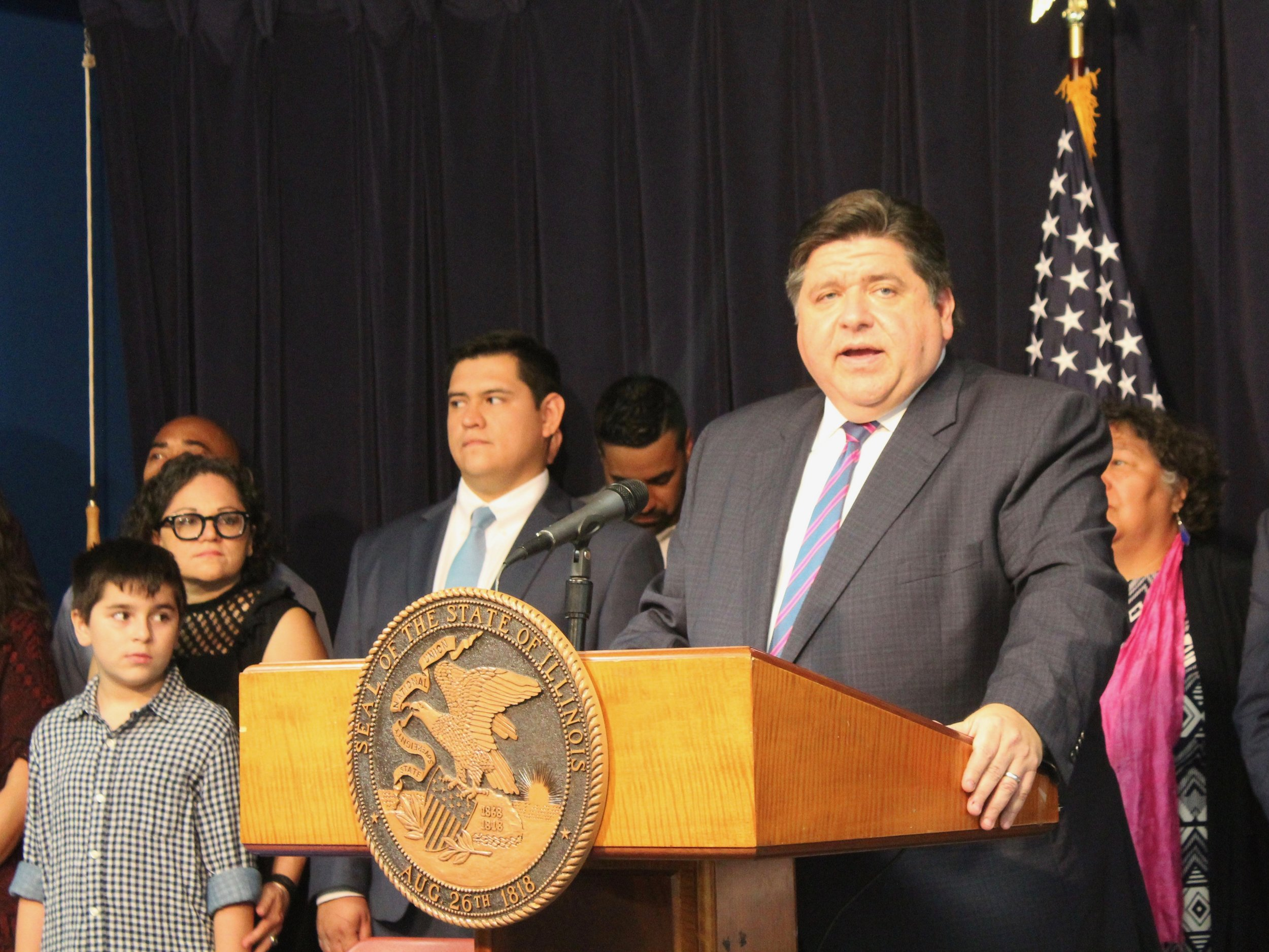 """Gov. Pritzker said a new law protecting immigrants from threats by landlords was in direct response to """"the racist and xenophobic attacks from the White House."""" (One Illinois/Ted Cox)"""