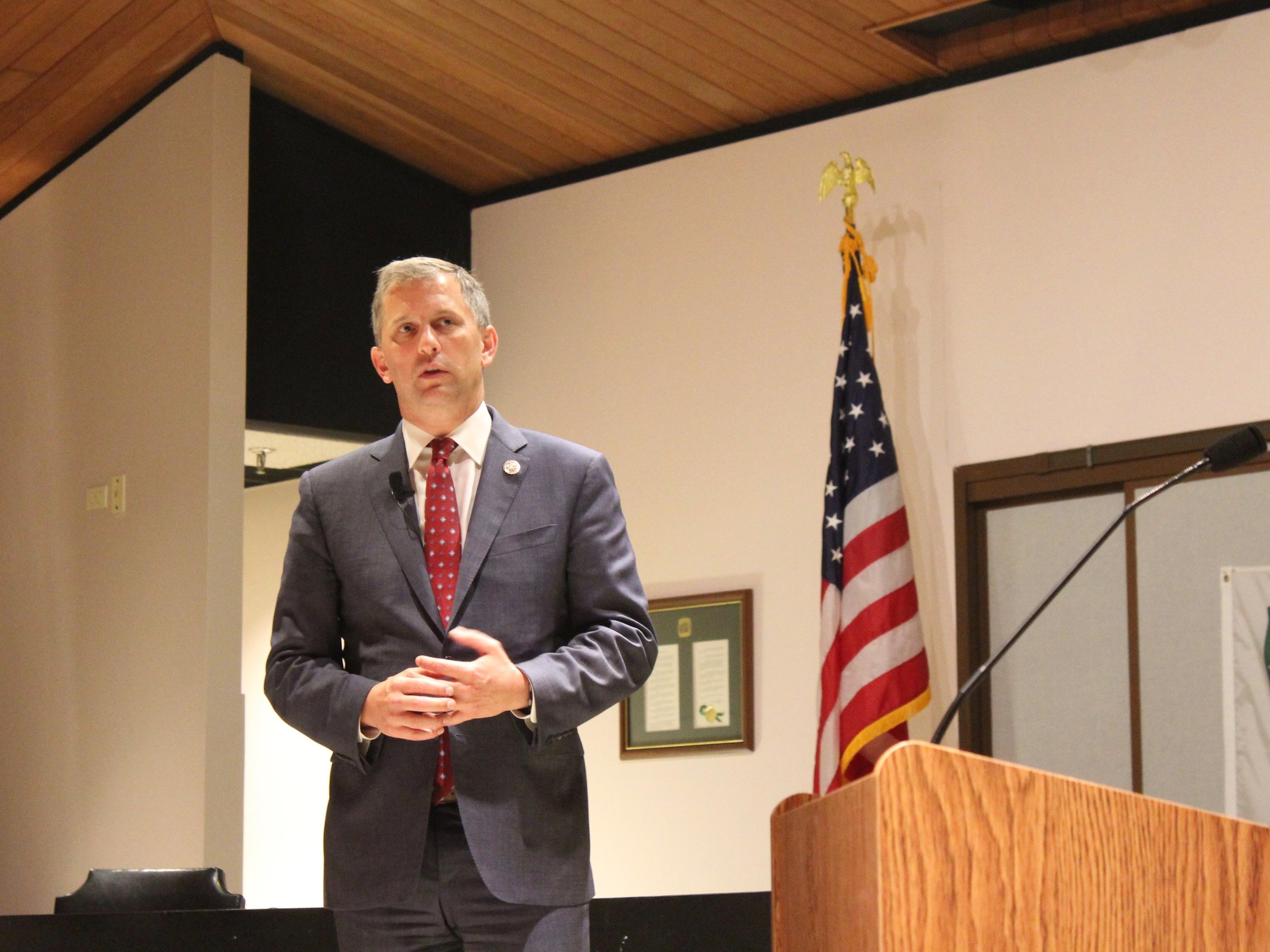 U.S. Rep. Sean Casten addresses a packed house at the Downers Grove Village Hall Wednesday. (One Illinois/Ted Cox)