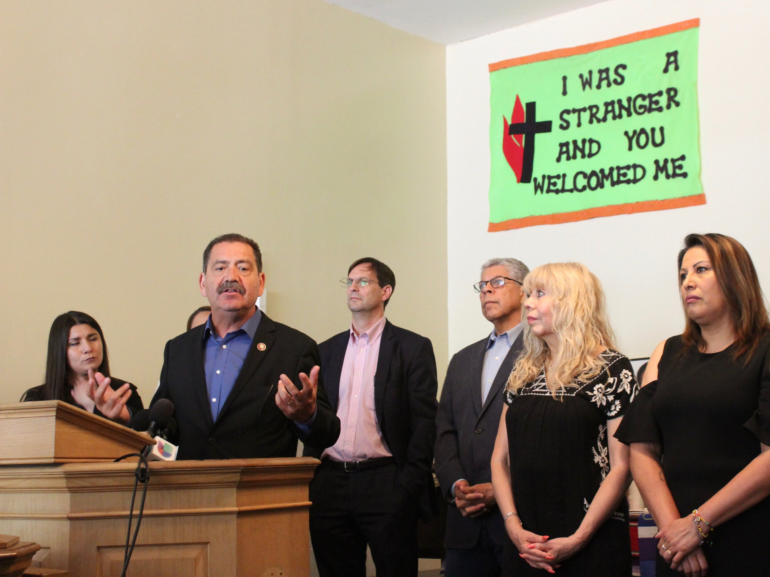 """U.S. Rep. Jesus """"Chuy"""" Garcia speaks in defense of immigrants at a Chicago news conference this summer. (One Illinois/Ted Cox)"""