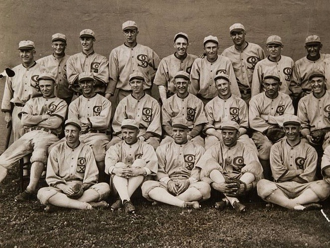 """The 1919 Chicago White Sox: top row, left to right: manager Kid Gleason, John Sullivan, Roy Wilkinson, Grover Lowdermilk, Swede Risberg(X), Fred McMullin(X), Bill James, Eddie Murphy, Shoeless Joe Jackson(X); middle row: Ray Schalk, Shano Collins, Red Faber, Dickey Kerr, Happy Felsch(X), Chick Gandil(X), Buck Weaver(X); bottom row: Eddie Collins, Nemo Leibold, Eddie Cicotte(X), Erskine Mayer, Lefty Williams(X); cropped out at right: Joe Jenkins, Byrd Lynn. The """"Eight Men Out"""" are marked with X's."""