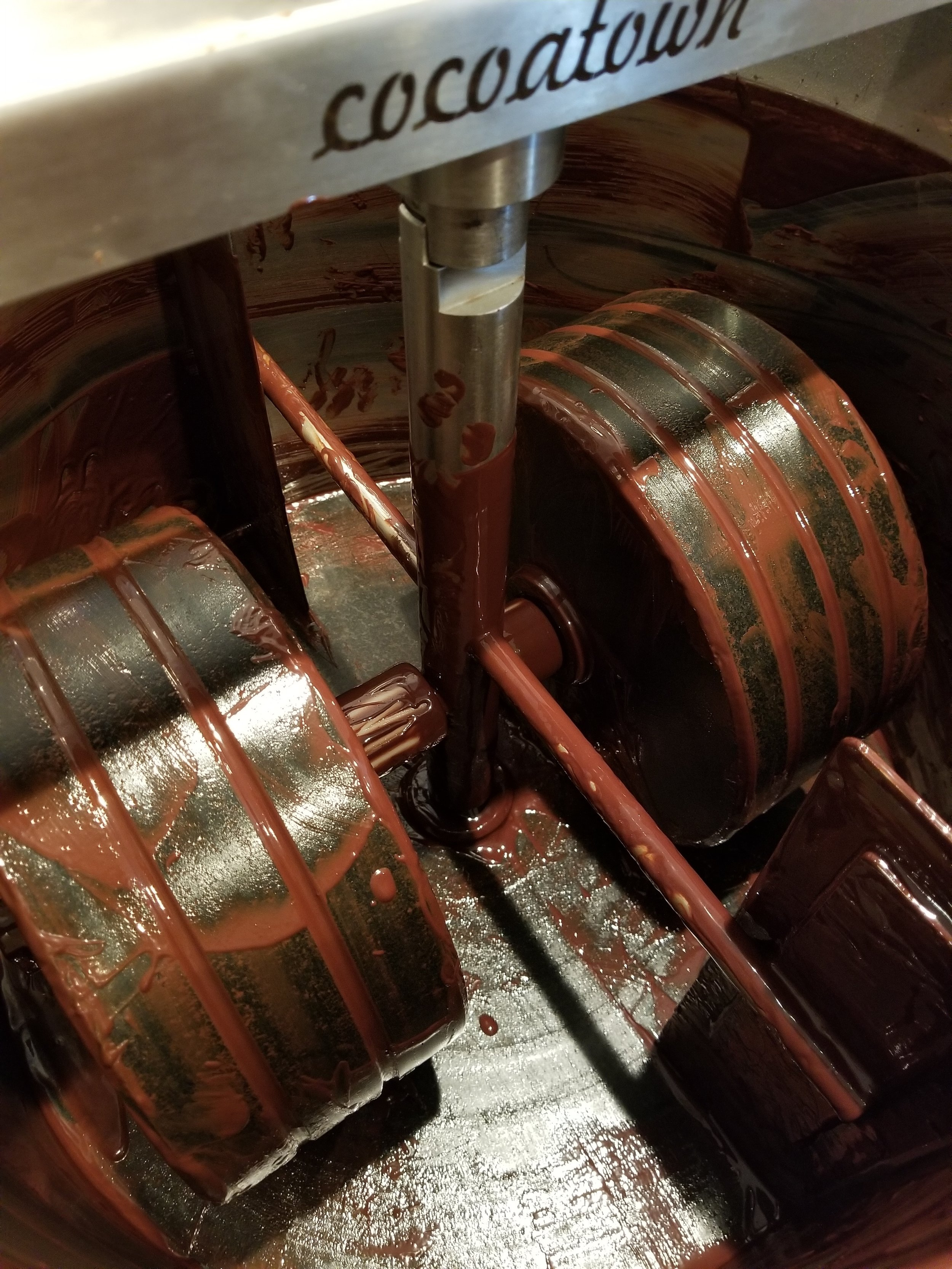 100 pounds of chocolate was just emptied from this grinder, if you were here you could have licked the bowl!  LOL